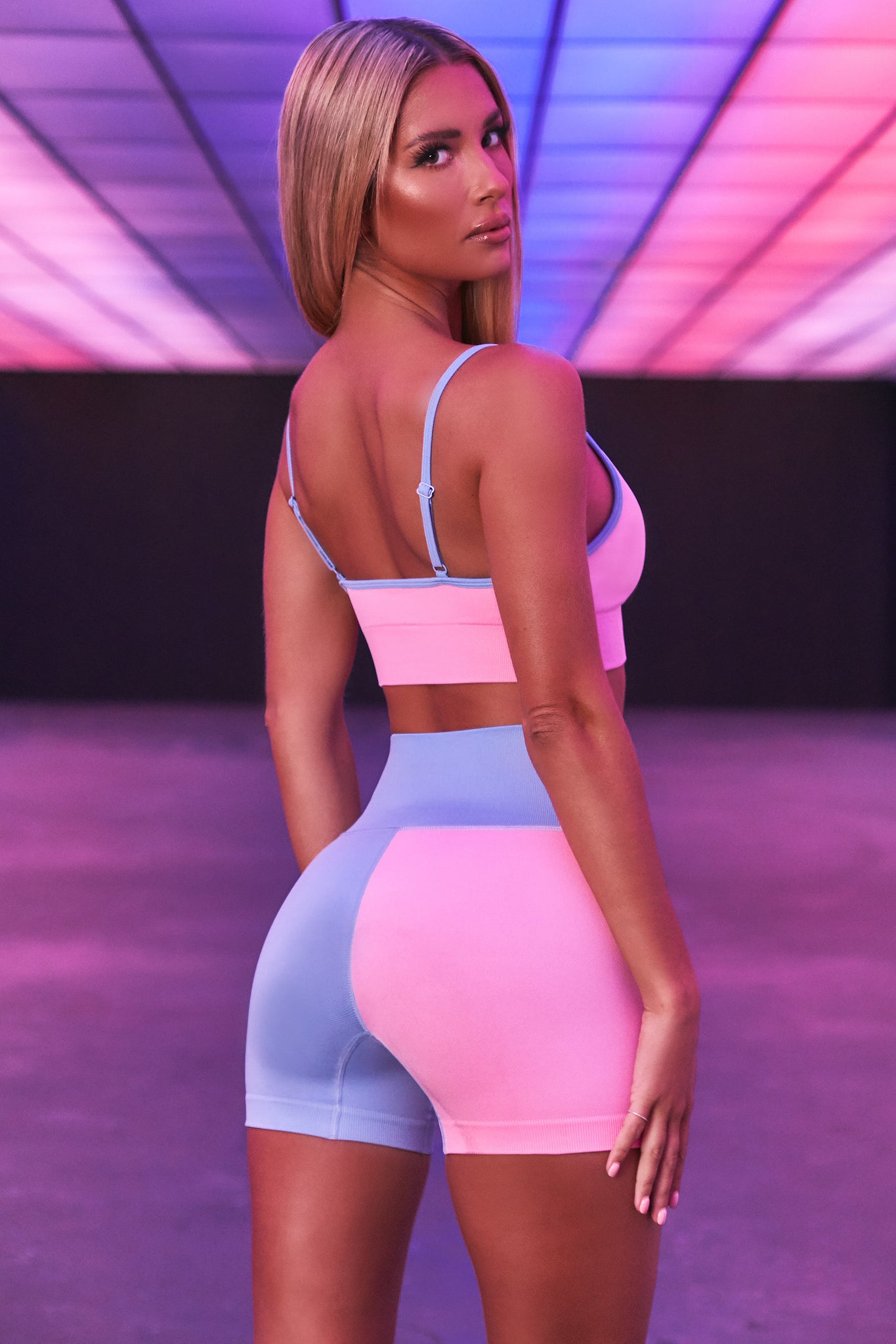 High waisted seamless shorts with one pink leg and one blue leg. 3D logo branding. Image 3 of 6.