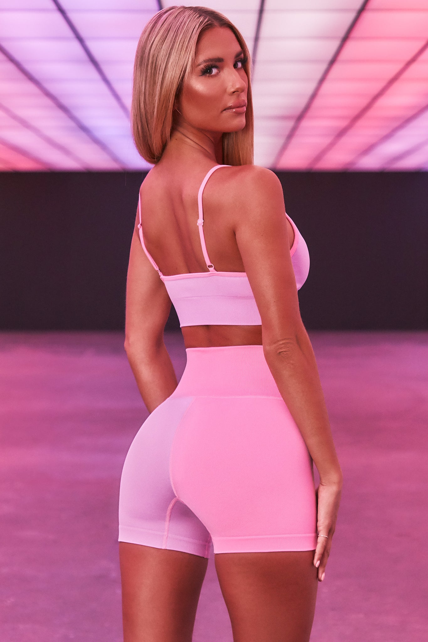 High waisted seamless shorts with one pink leg and one lilac leg. 3D logo branding. Image 3 of 6.