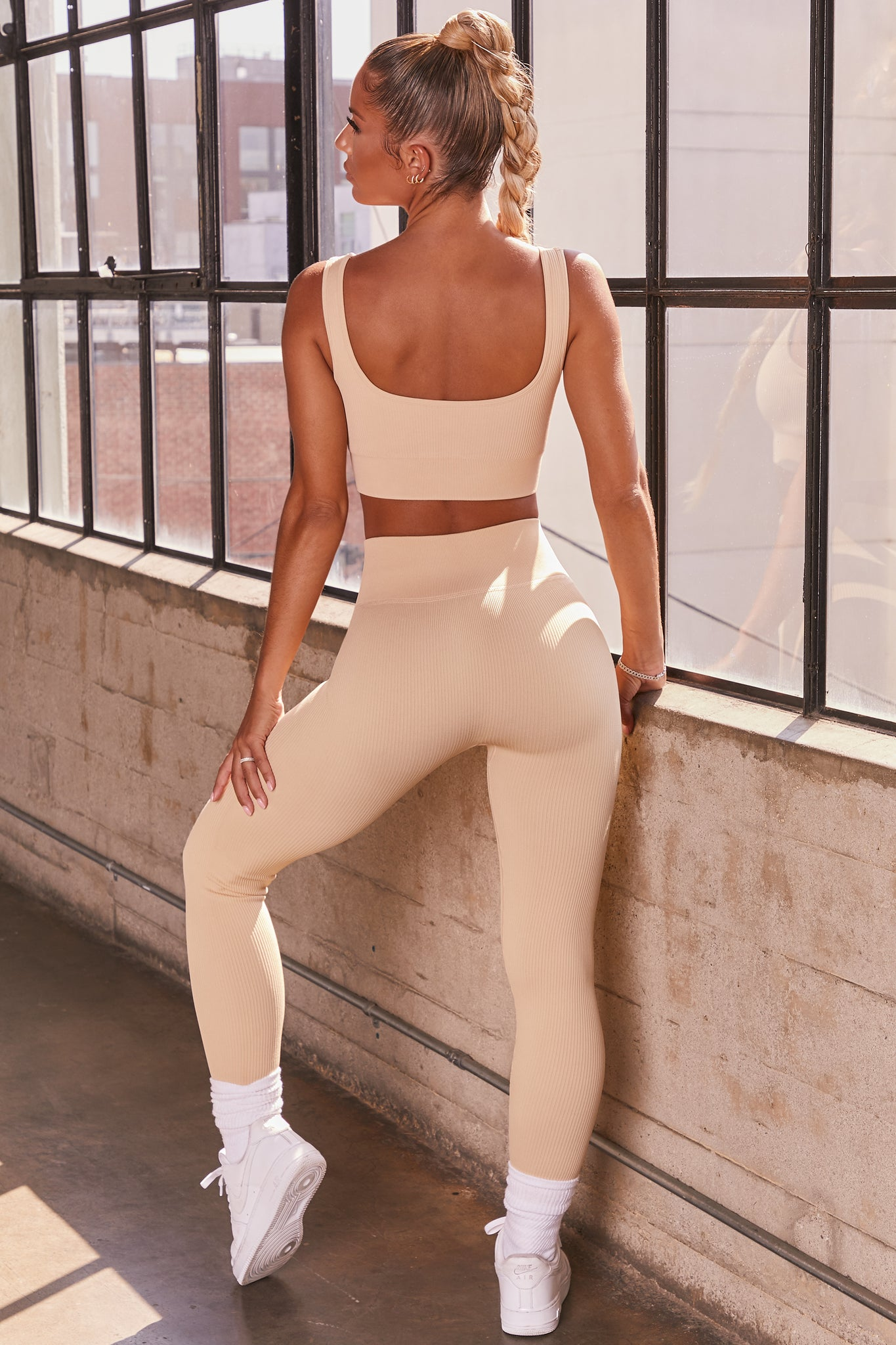 Cream ribbed full length high waisted leggings. Image 3 of 6.