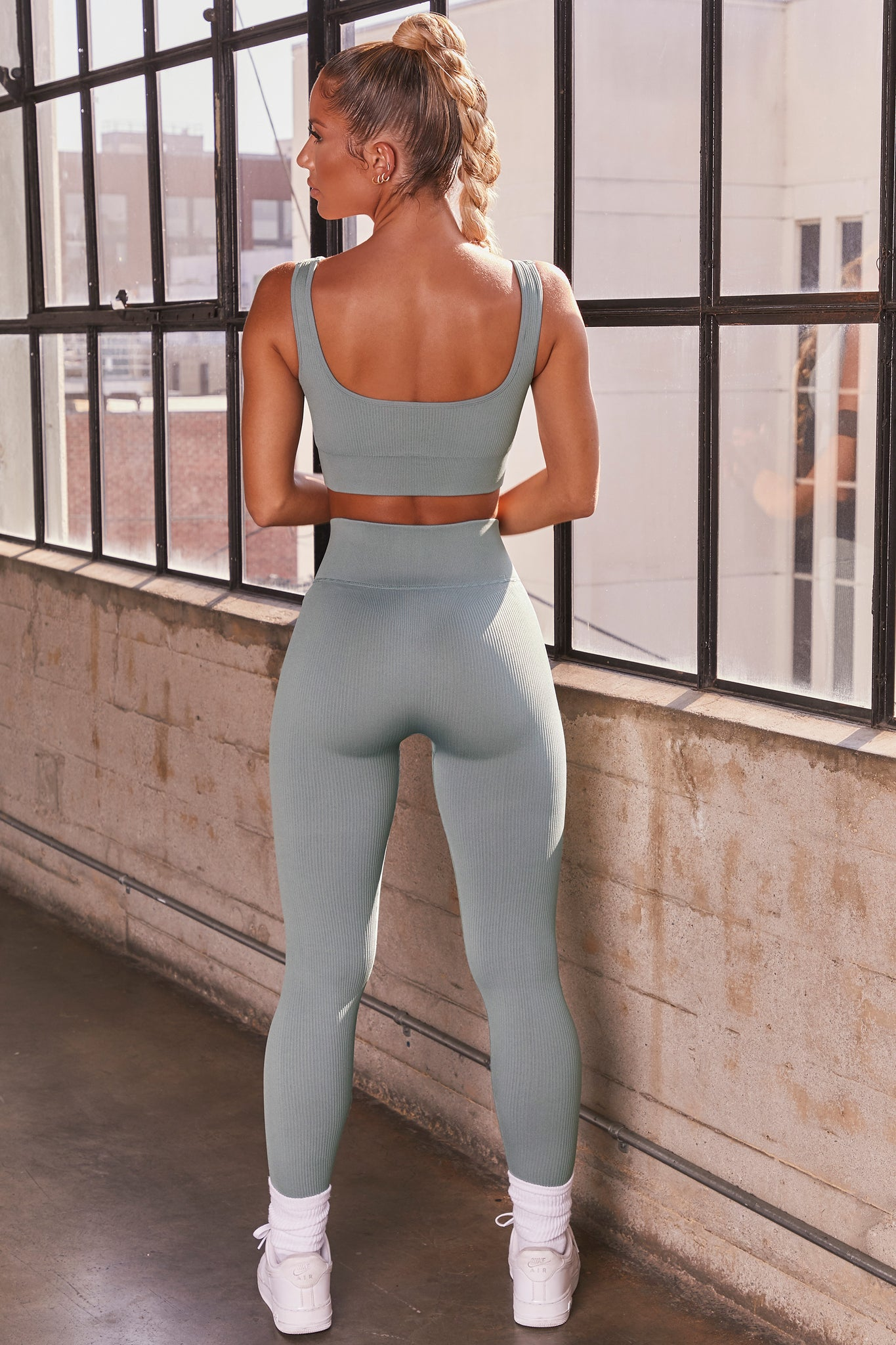 Blue ribbed full length high waisted leggings. Image 3 of 6.