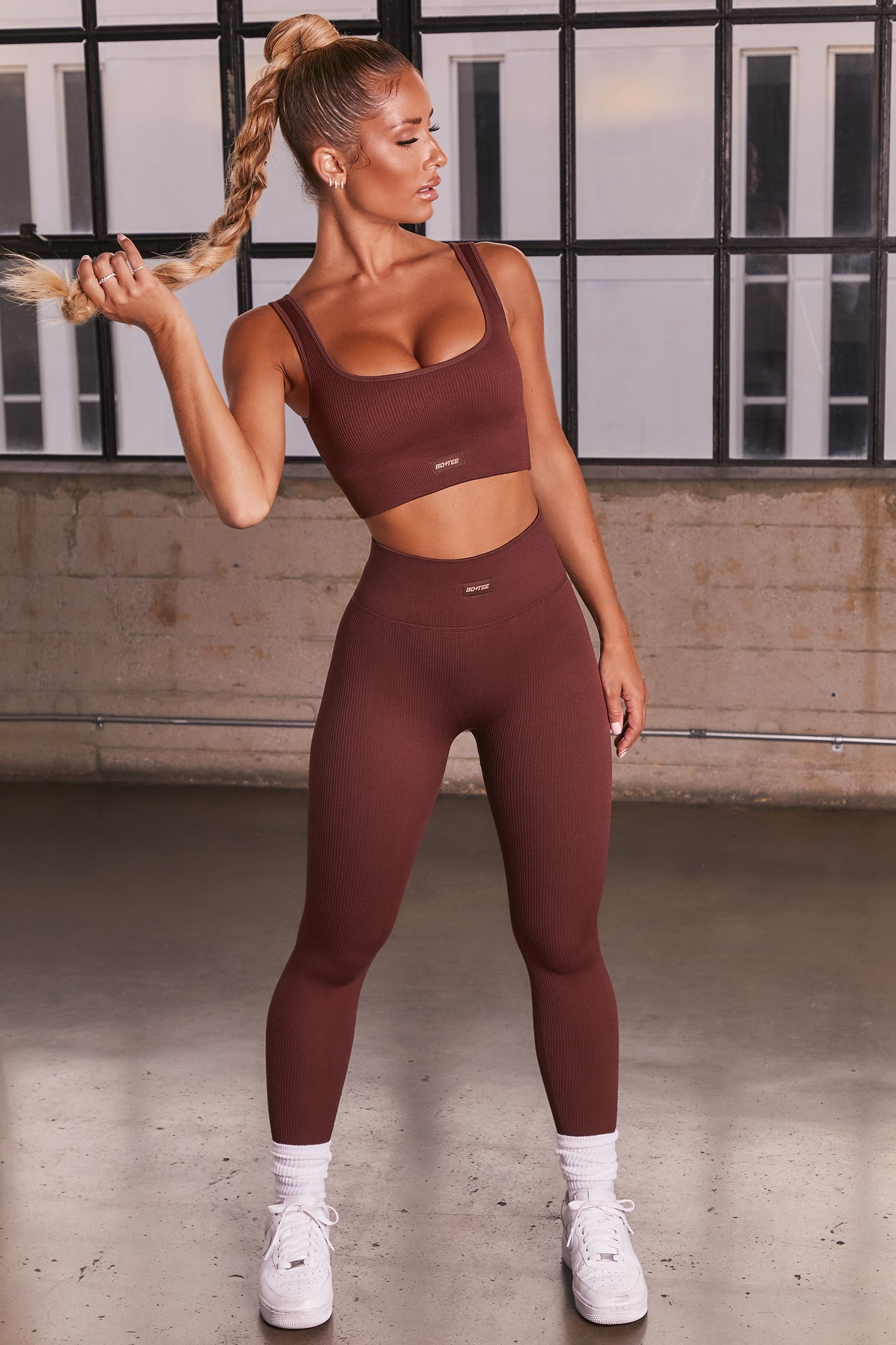 Dark Brown ribbed full length high waisted leggings. Image 1 of 6.