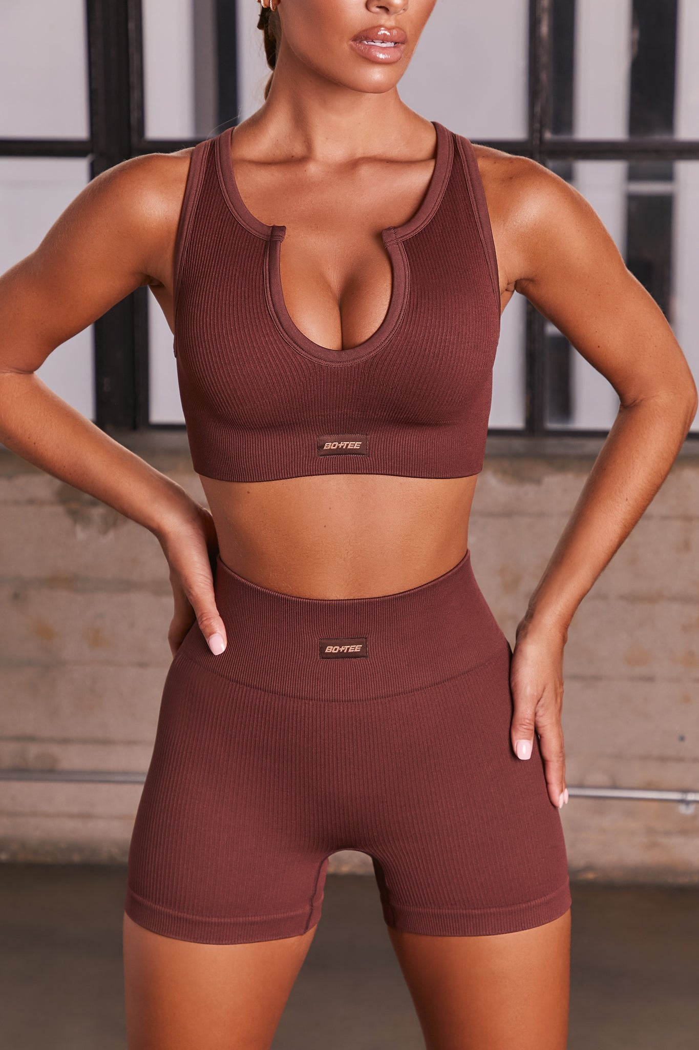 Dark Brown ribbed notch neck sports bra. Image 1 of 6.