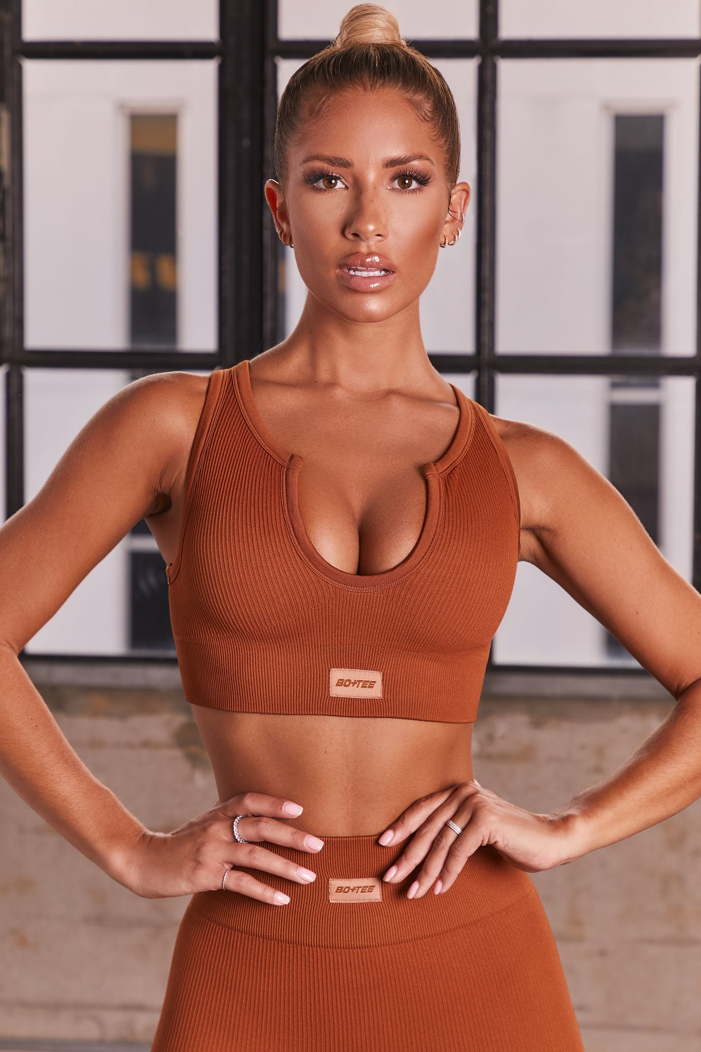 Light Brown ribbed notch neck sports bra. Image 1 of 6.