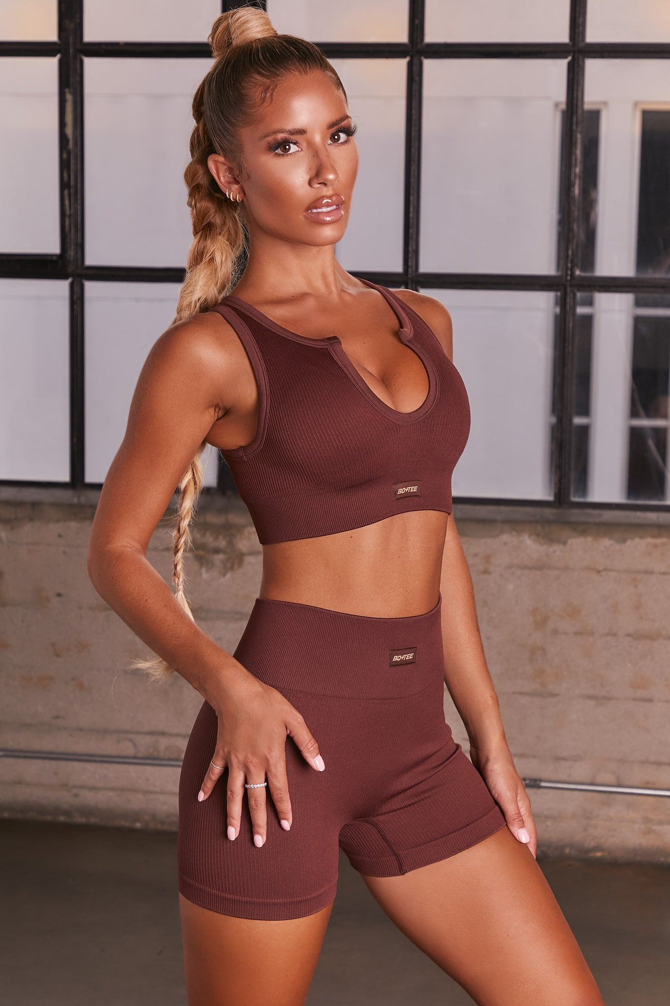 Dark Brown ribbed notch neck sports bra. Image 2 of 6.