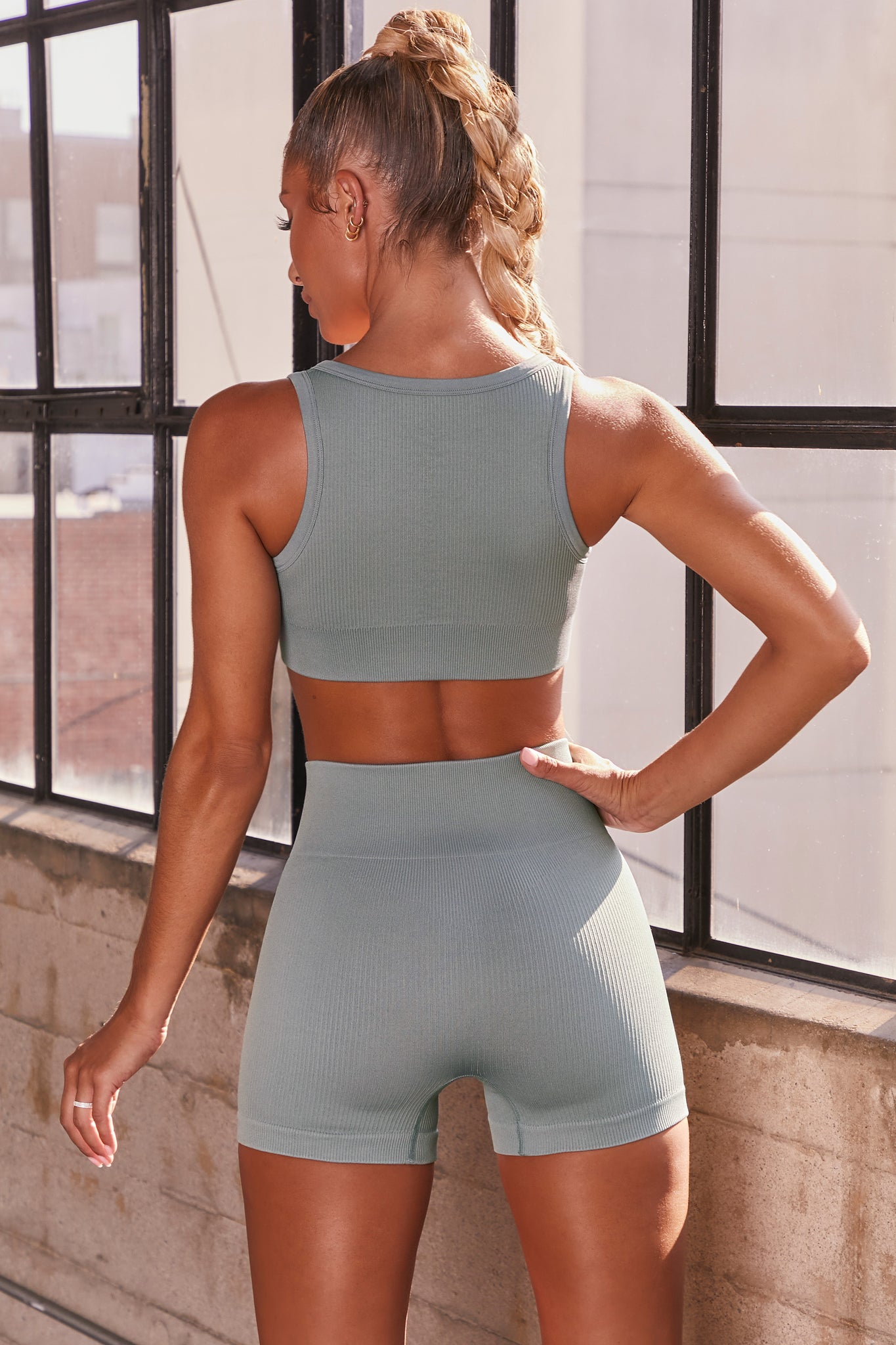 Blue ribbed notch neck sports bra. Image 3 of 6.