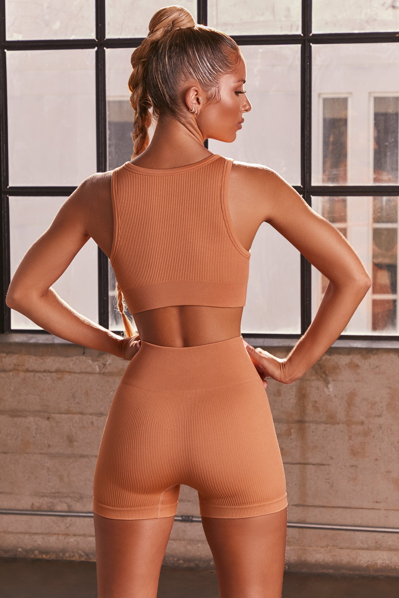Caramel ribbed high waisted mini gym shorts. Image 3 of 6.