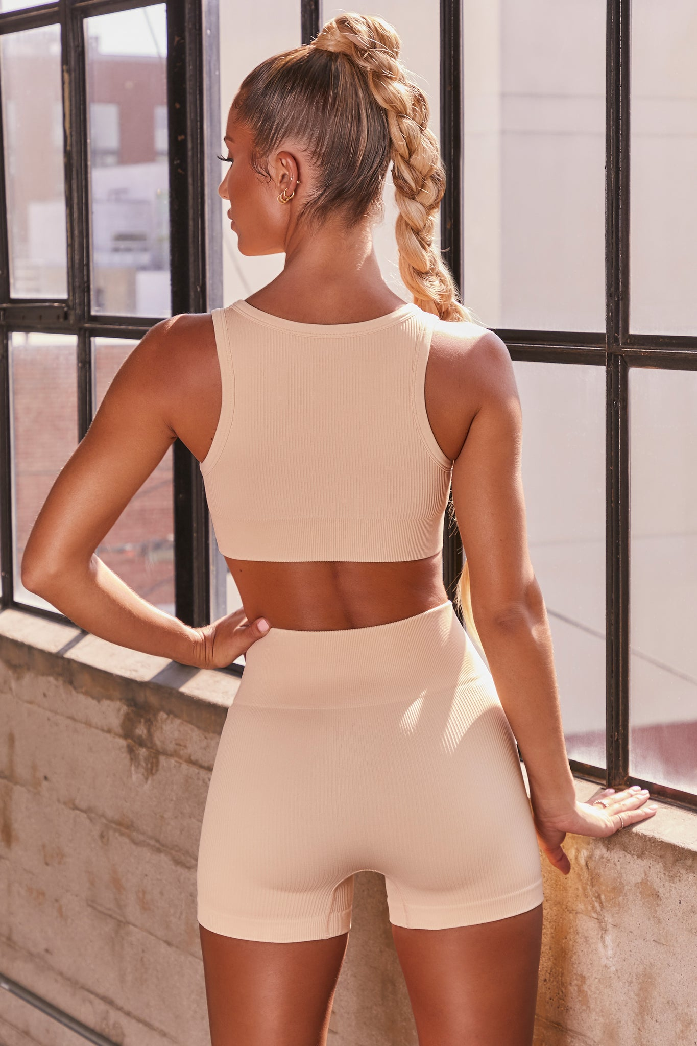 Cream ribbed notch neck sports bra. Image 3 of 6.