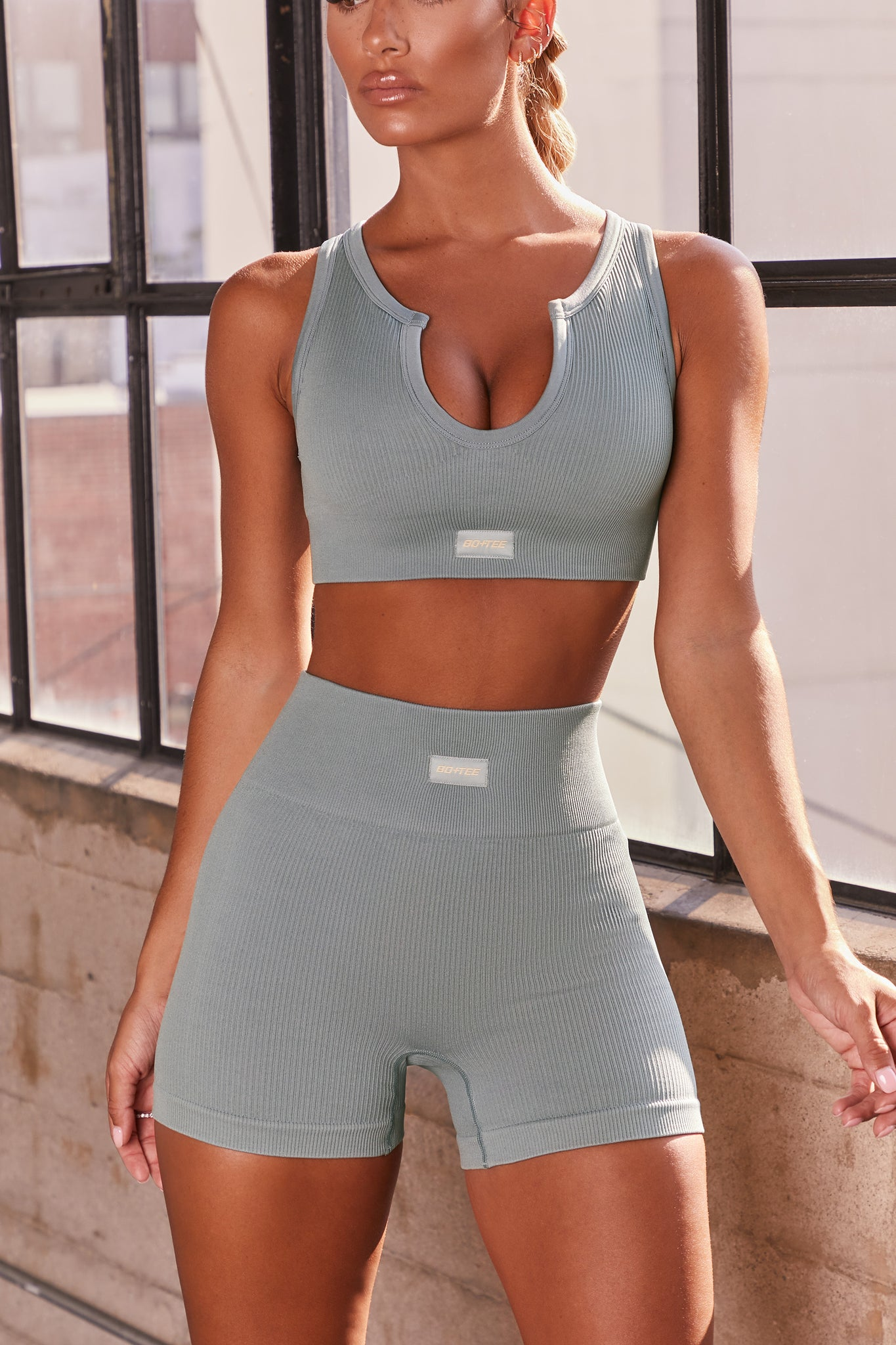 Blue ribbed notch neck sports bra. Image 1 of 6.