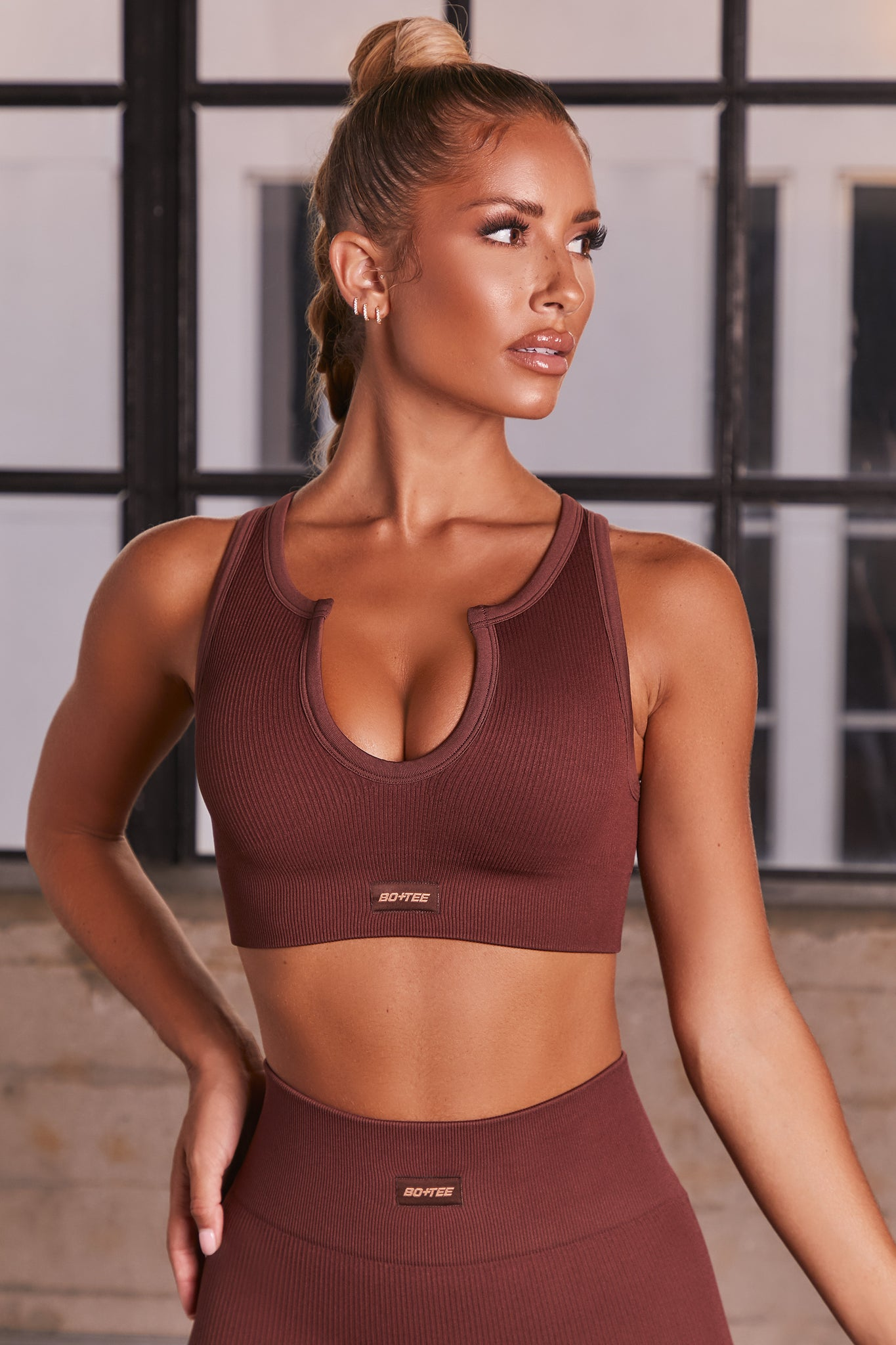 Dark Brown ribbed notch neck sports bra. Image 4 of 6.