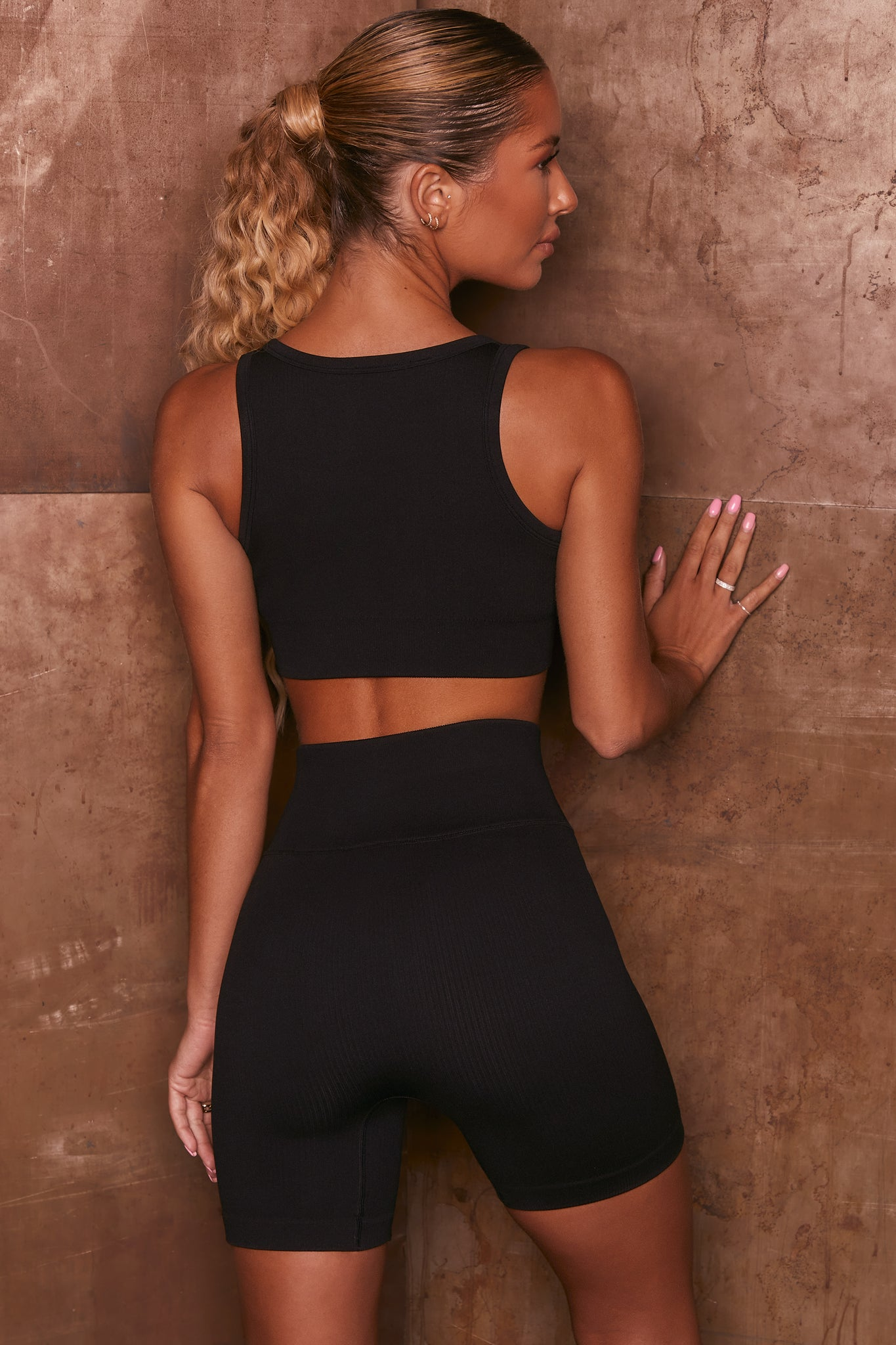Black ribbed high waisted cycling shorts. Image 3 of 6.