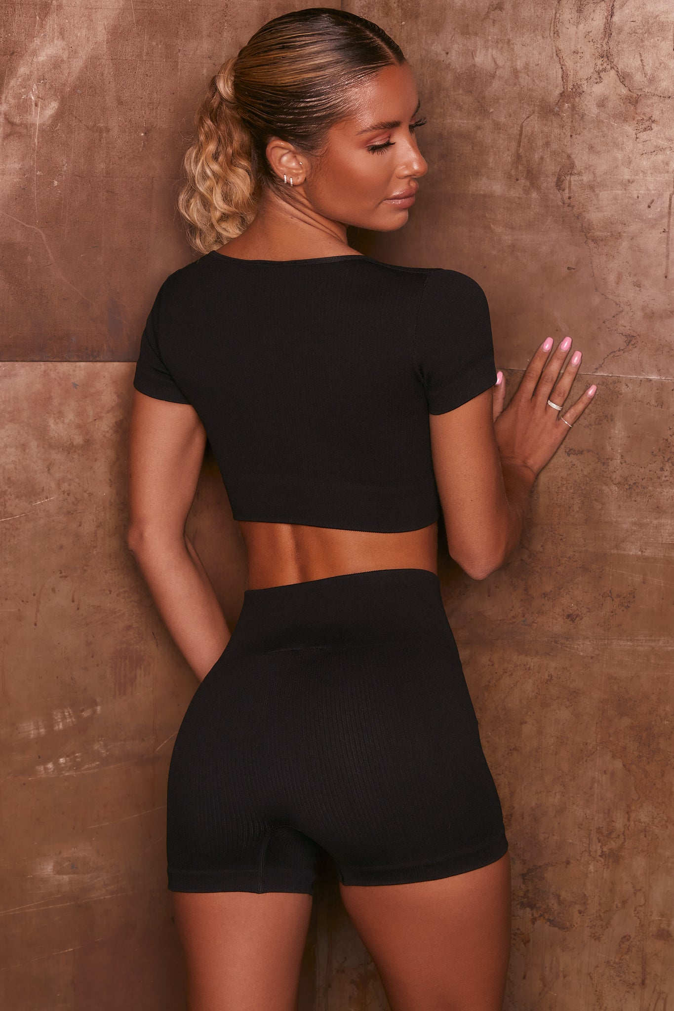 Black ribbed short sleeve notch neck crop top. Image 3 of 6.