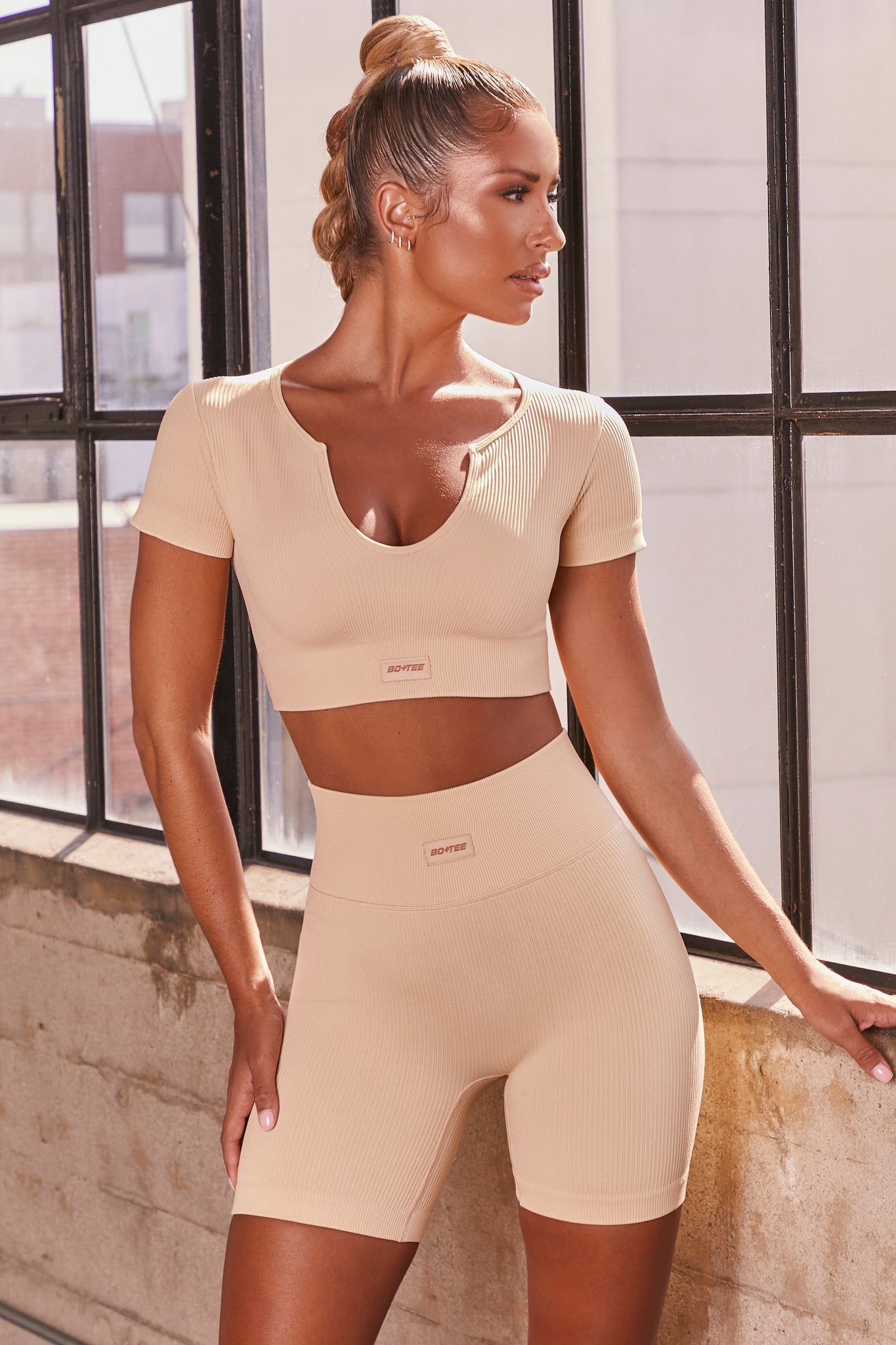 Cream ribbed high waisted cycling shorts. Image 1 of 6.