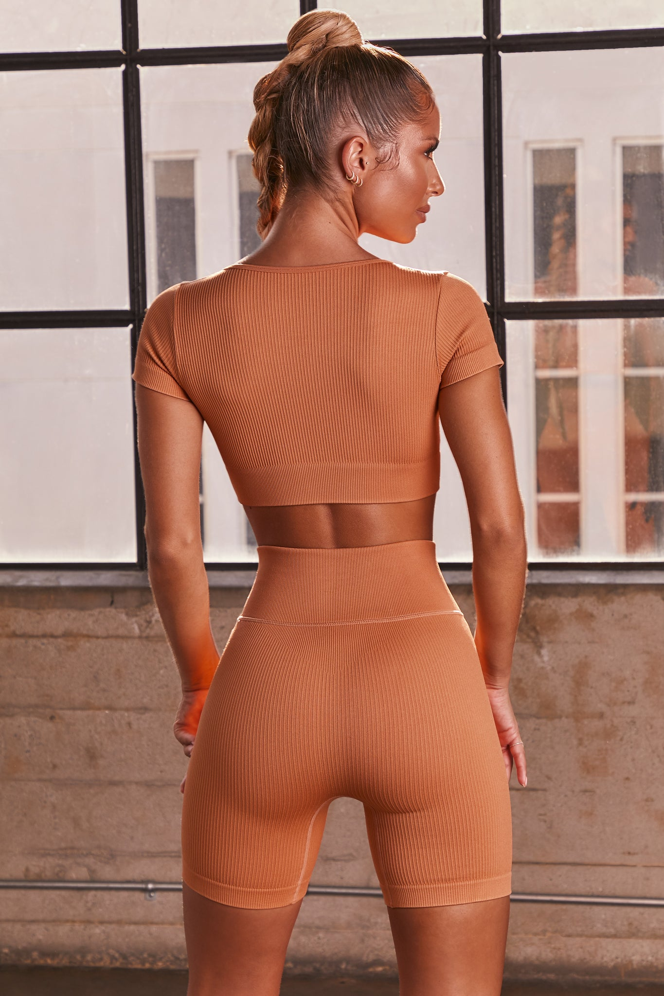 Caramel ribbed short sleeve notch neck crop top. Image 3 of 6.
