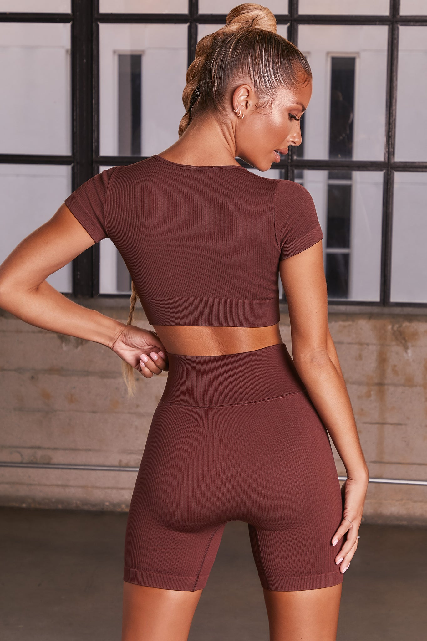 Dark Brown ribbed short sleeve notch neck crop top. Image 3 of 6.