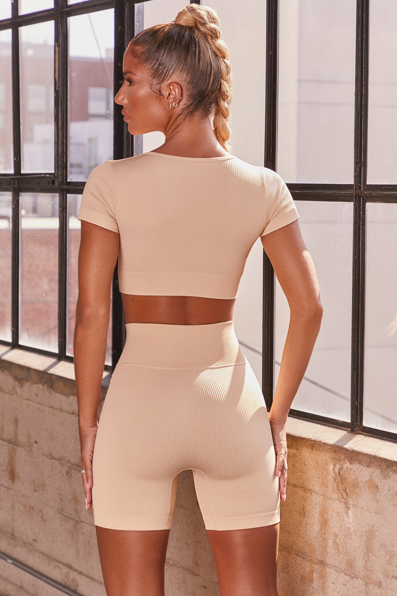 Cream ribbed short sleeve notch neck crop top. Image 3 of 6.