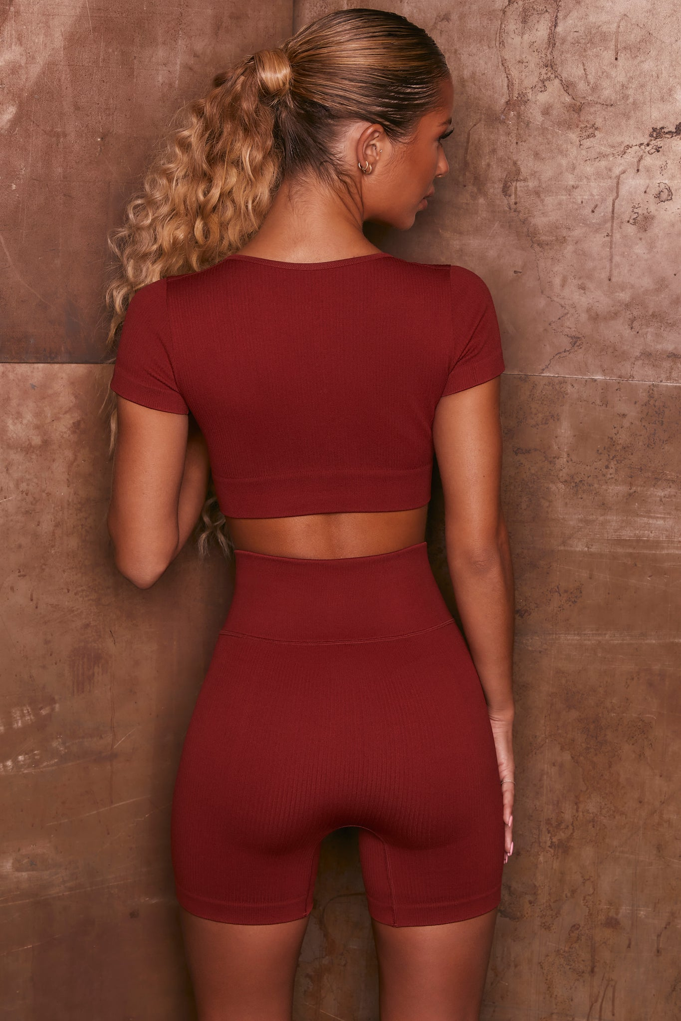 Burgundy ribbed short sleeve notch neck crop top. Image 3 of 6.
