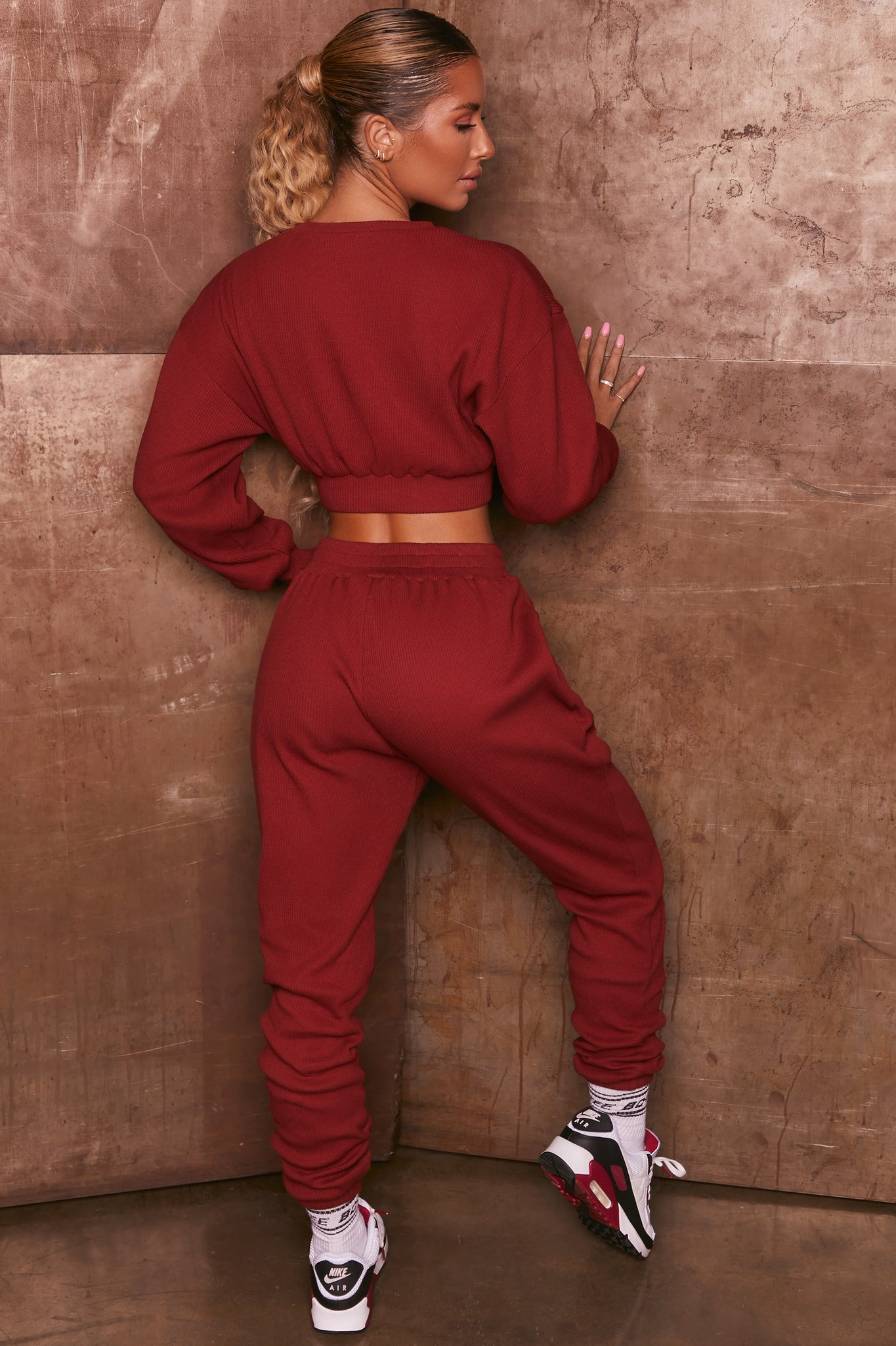 Burgundy ribbed full length cuffed joggers. Image 3 of 6.