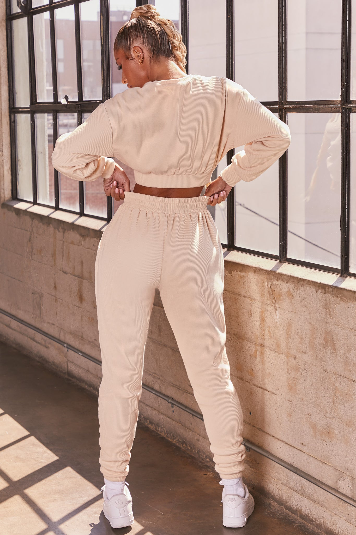 Cream ribbed long sleeve cropped sweatshirt. Image 3 of 6.