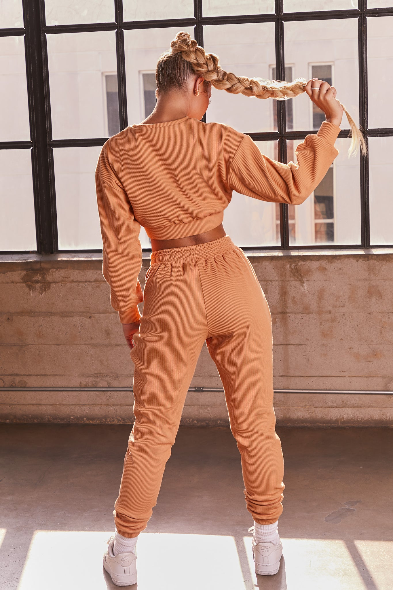 Caramel ribbed long sleeve cropped sweatshirt. Image 3 of 6.