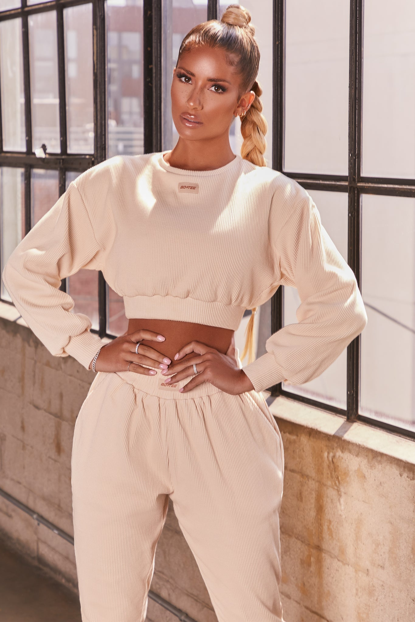 Cream ribbed long sleeve cropped sweatshirt. Image 1 of 6.