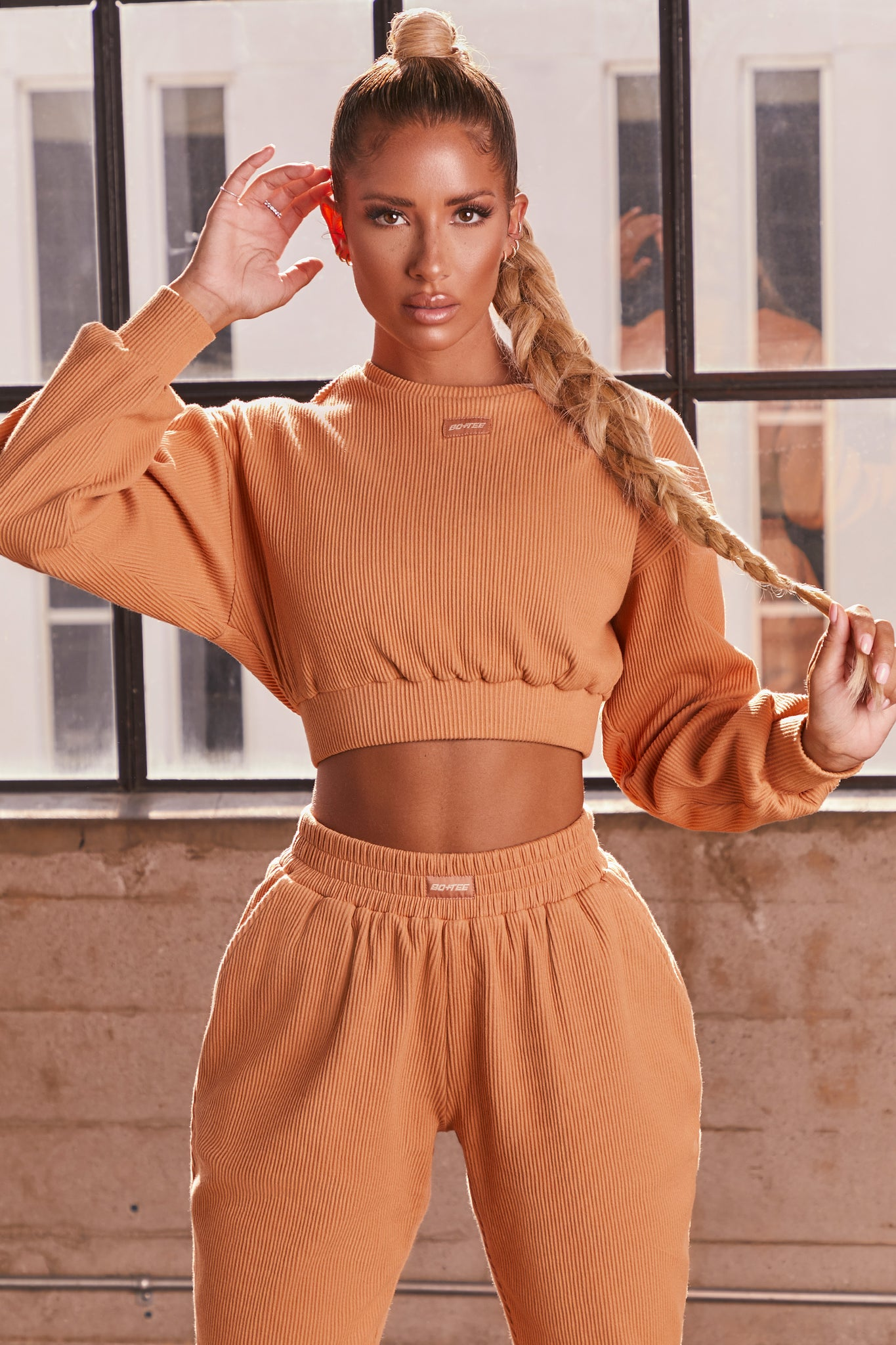 Caramel ribbed long sleeve cropped sweatshirt. Image 1 of 6.