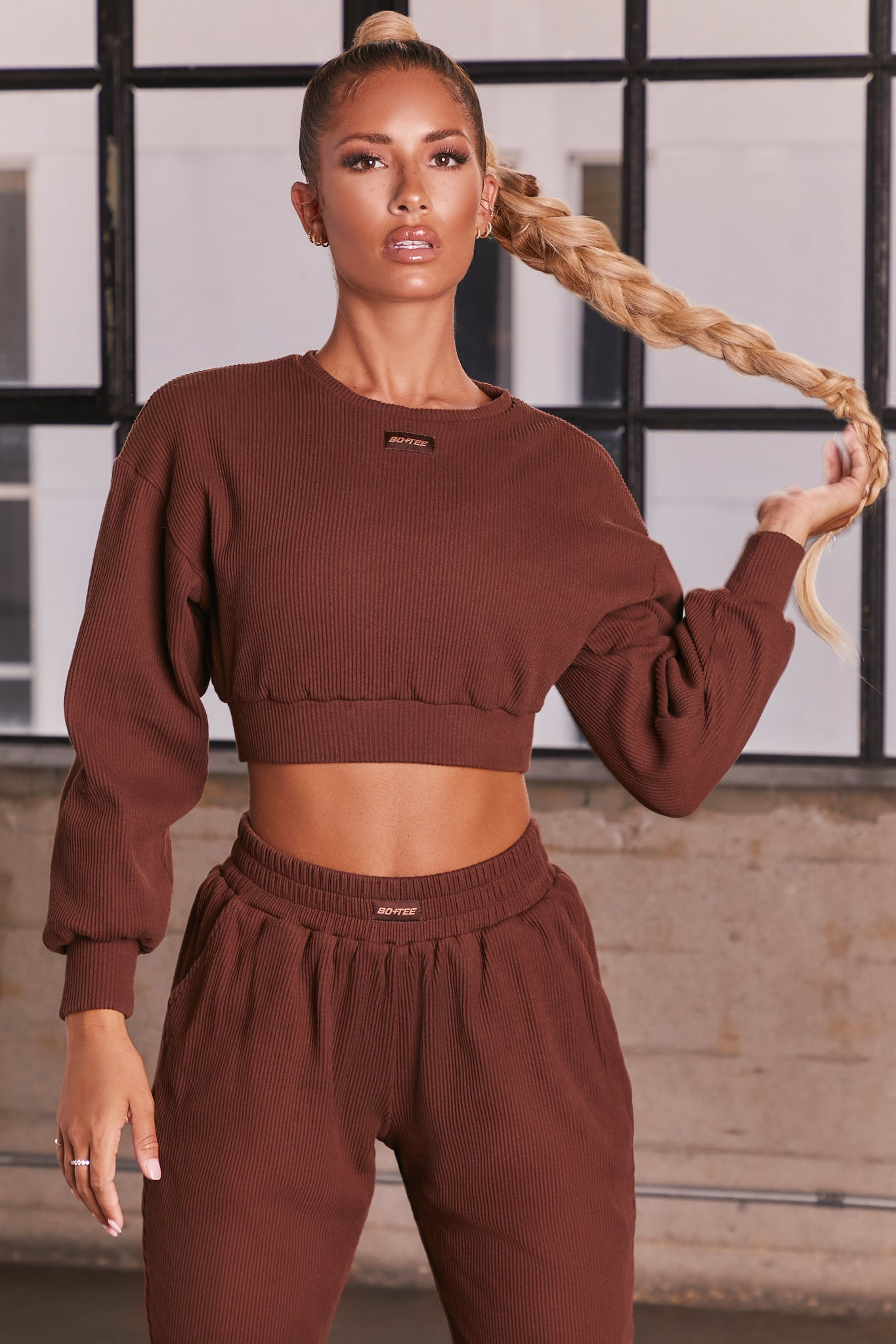 Dark Brown ribbed long sleeve cropped sweatshirt. Image 1 of 6.