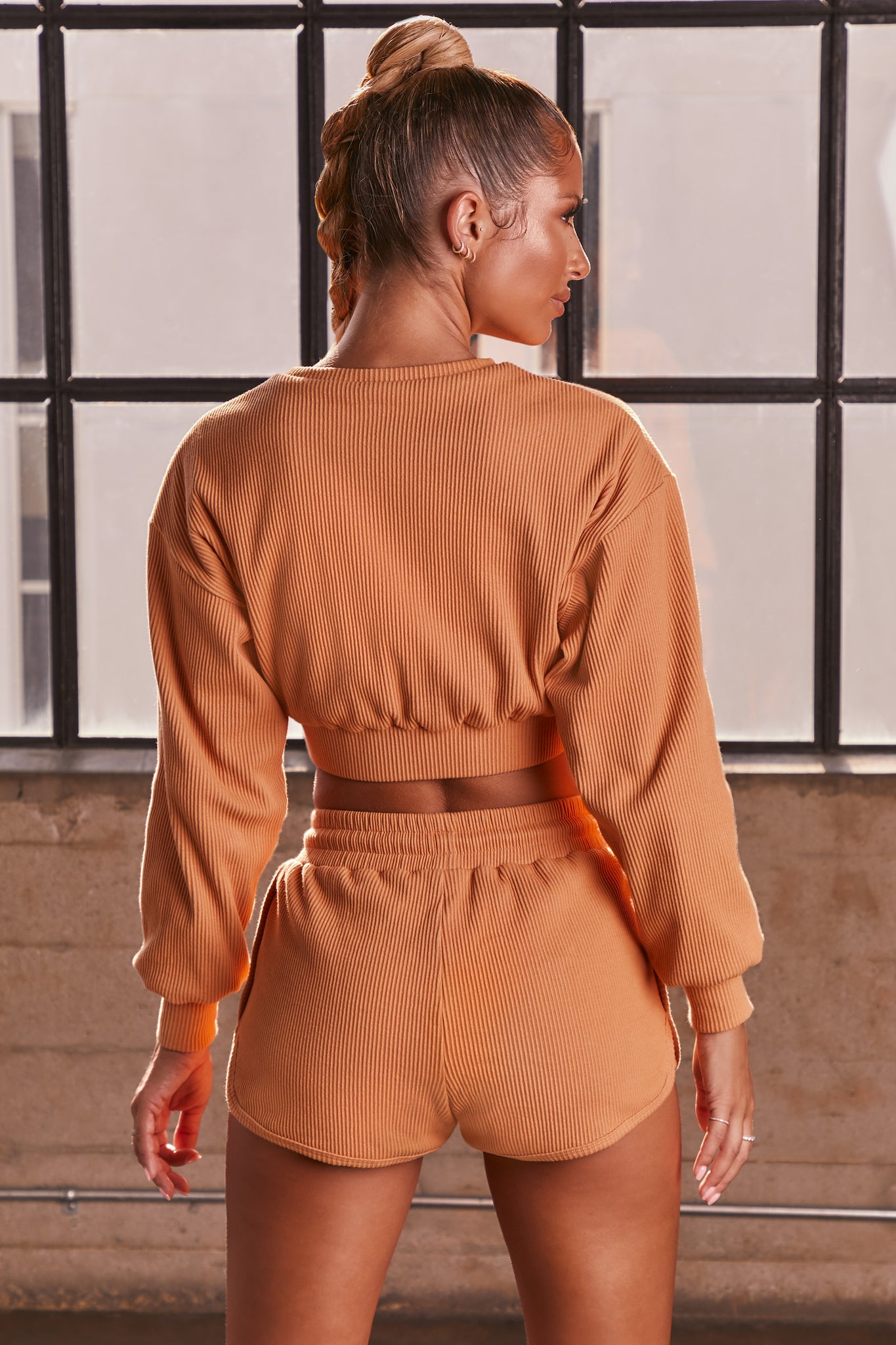 Caramel ribbed high waisted mini runner shorts. Image 3 of 6.