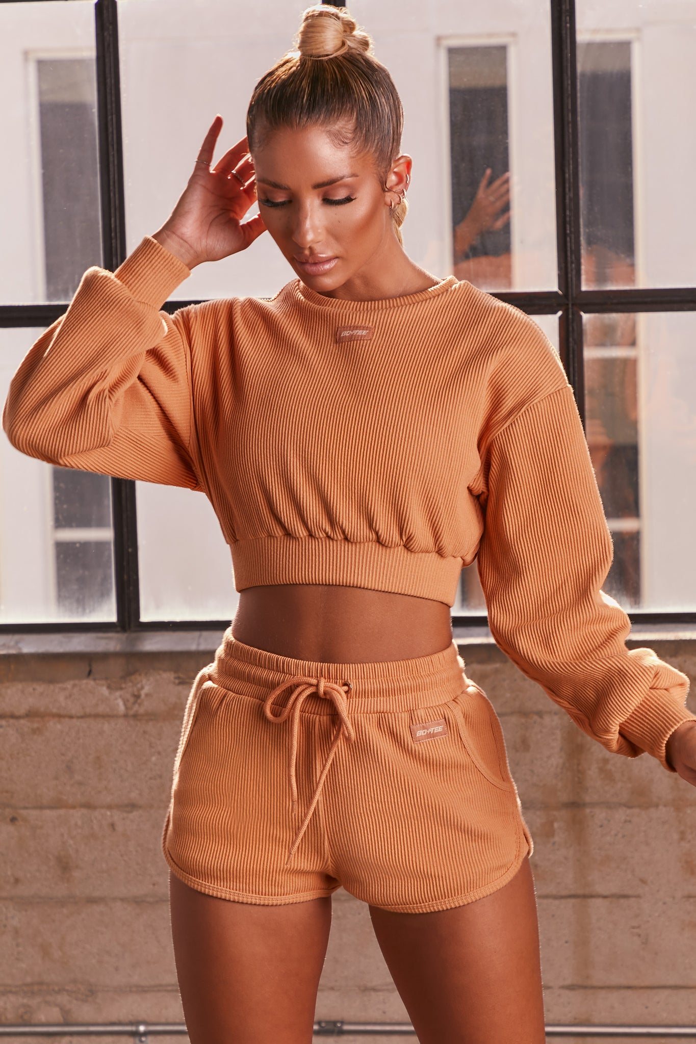 Caramel ribbed high waisted mini runner shorts. Image 1 of 6.