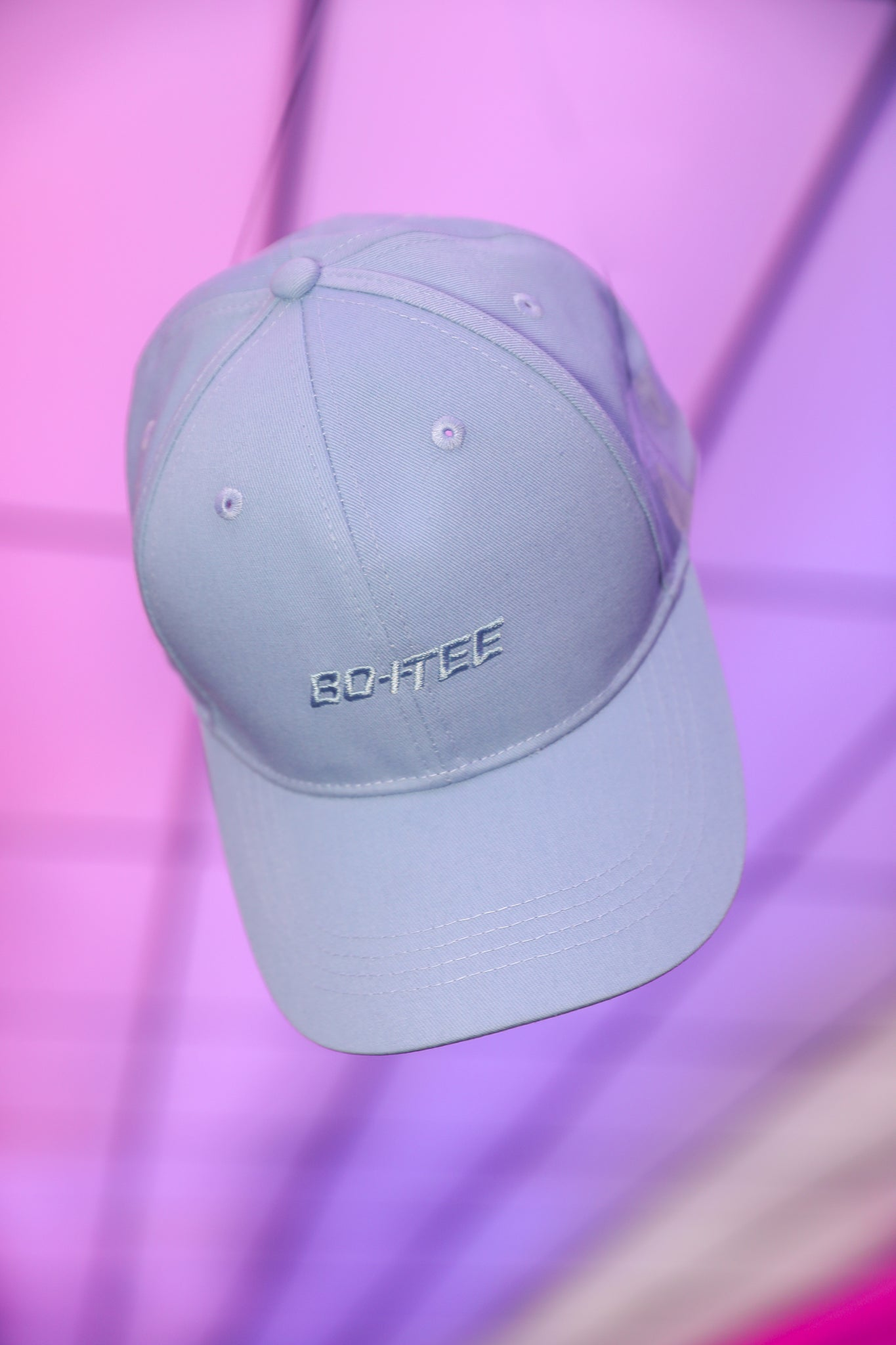 Blue baseball cap with embroidered logo in the centre. Image 3 of 6.