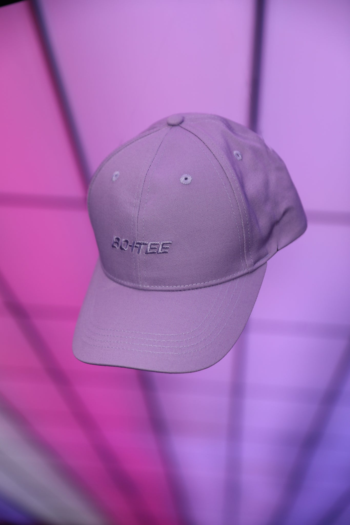 Lilac baseball cap with embroidered logo in the centre. Image 3 of 6.