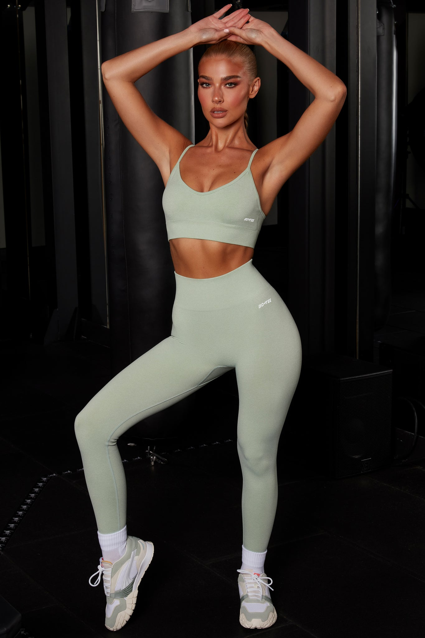 Plain green melange seamless full length leggings with high waist and reflective branding. Image 1 of 6.