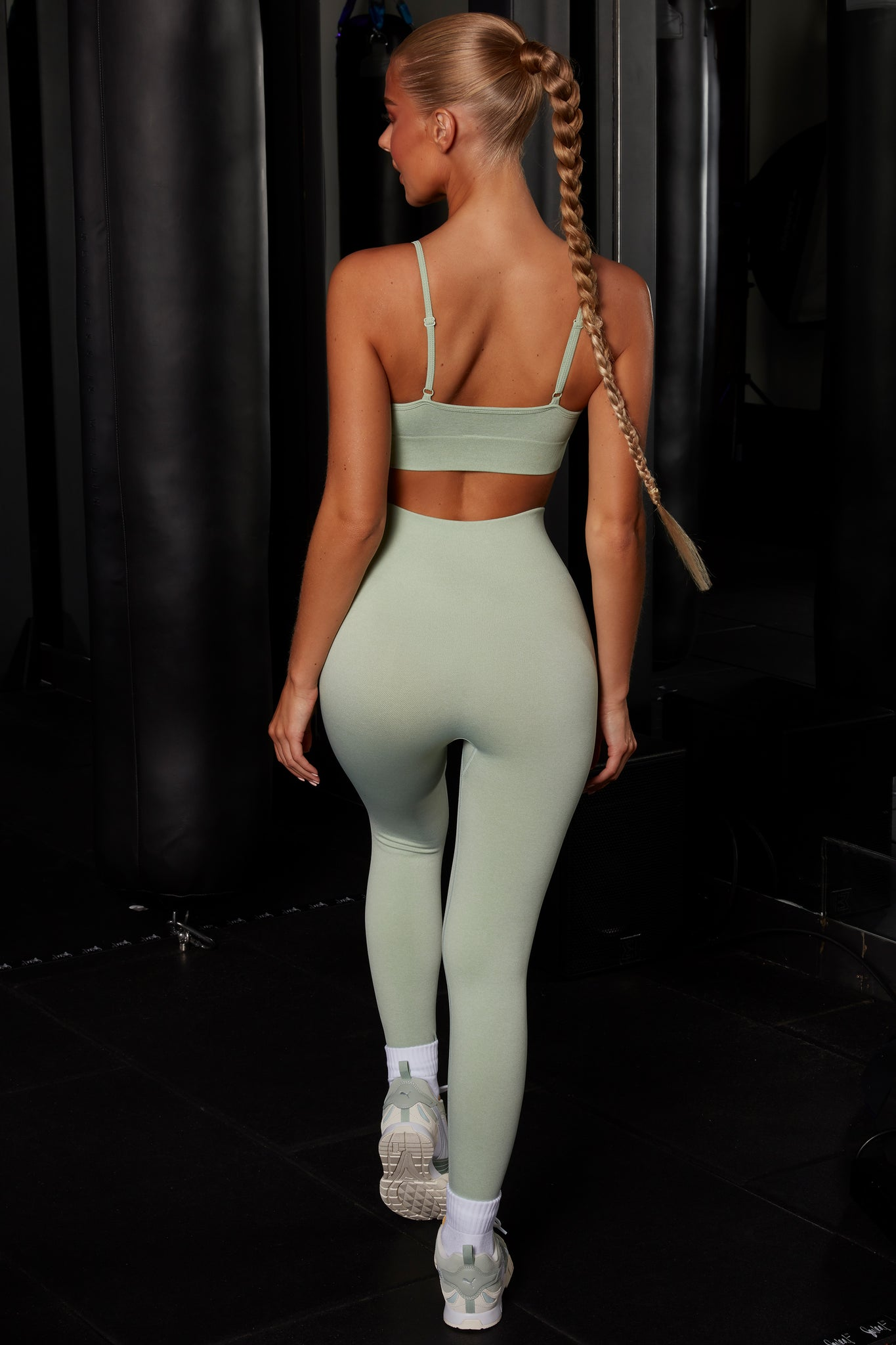 Plain green melange seamless full length leggings with high waist and reflective branding. Image 3 of 6.