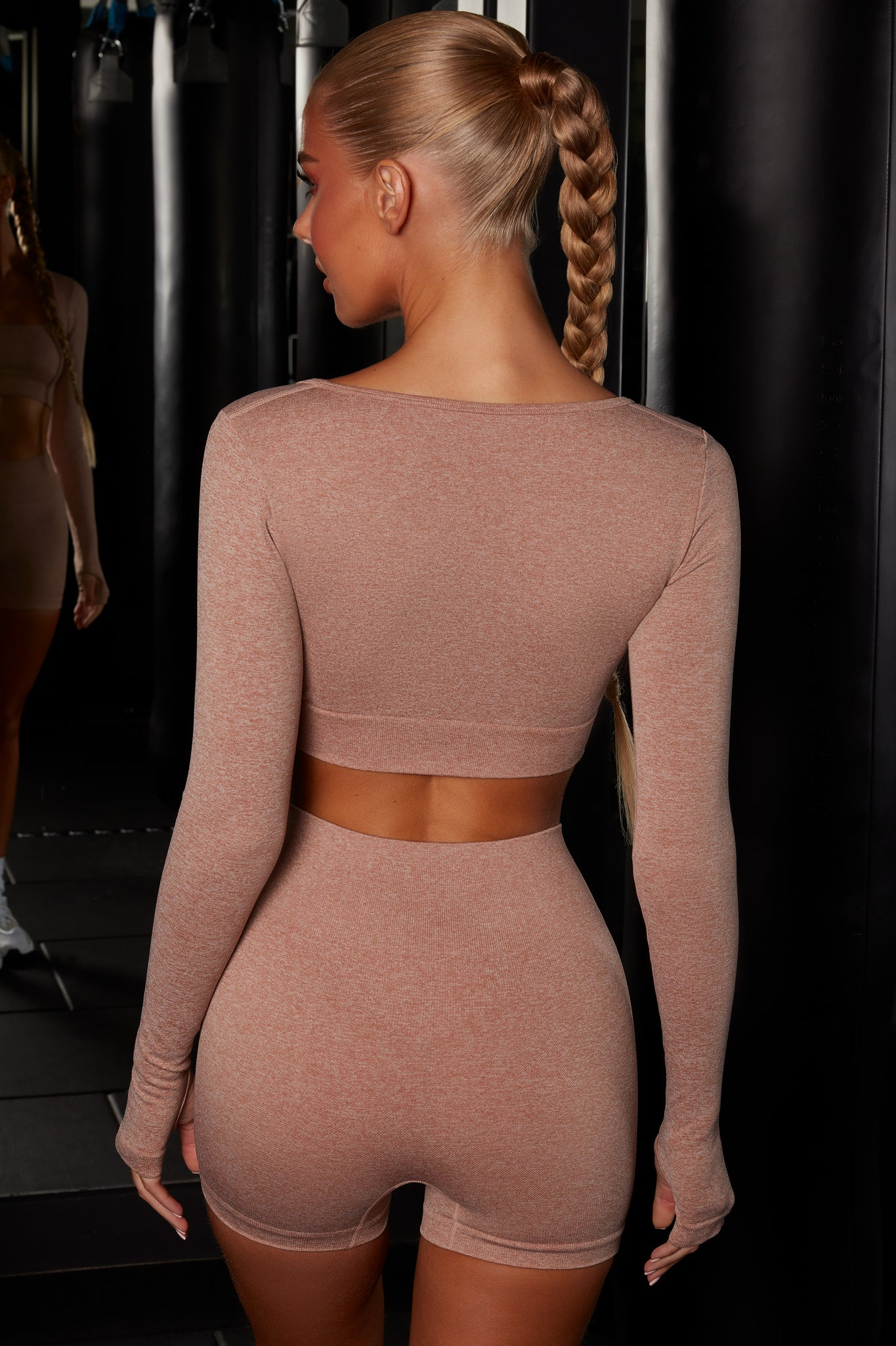 Plain brown melange scoop neck crop top with long sleeves. Image 3 of 6.