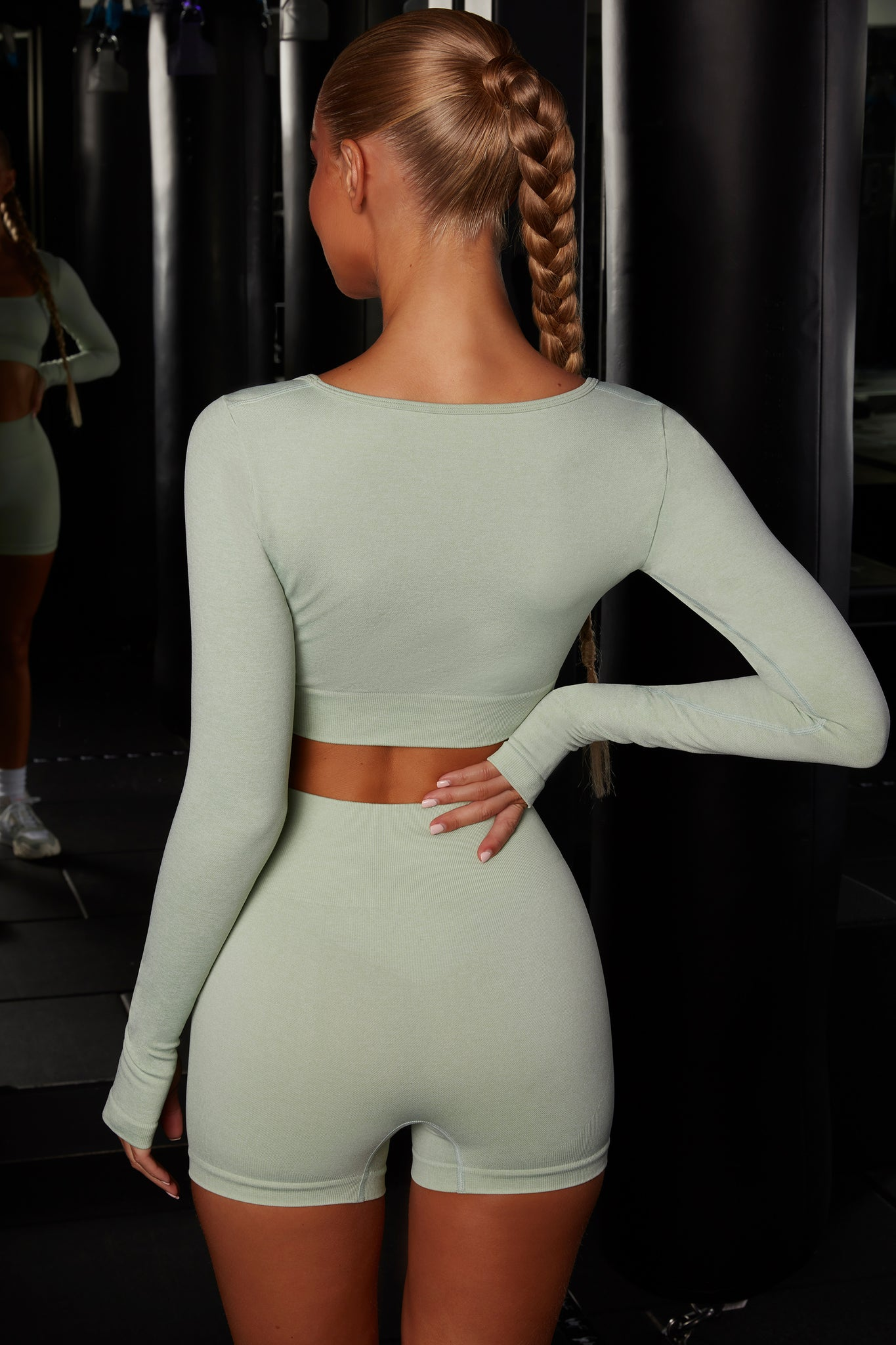 Plain green melange seamless high waisted mini shorts. Image 3 of 6.