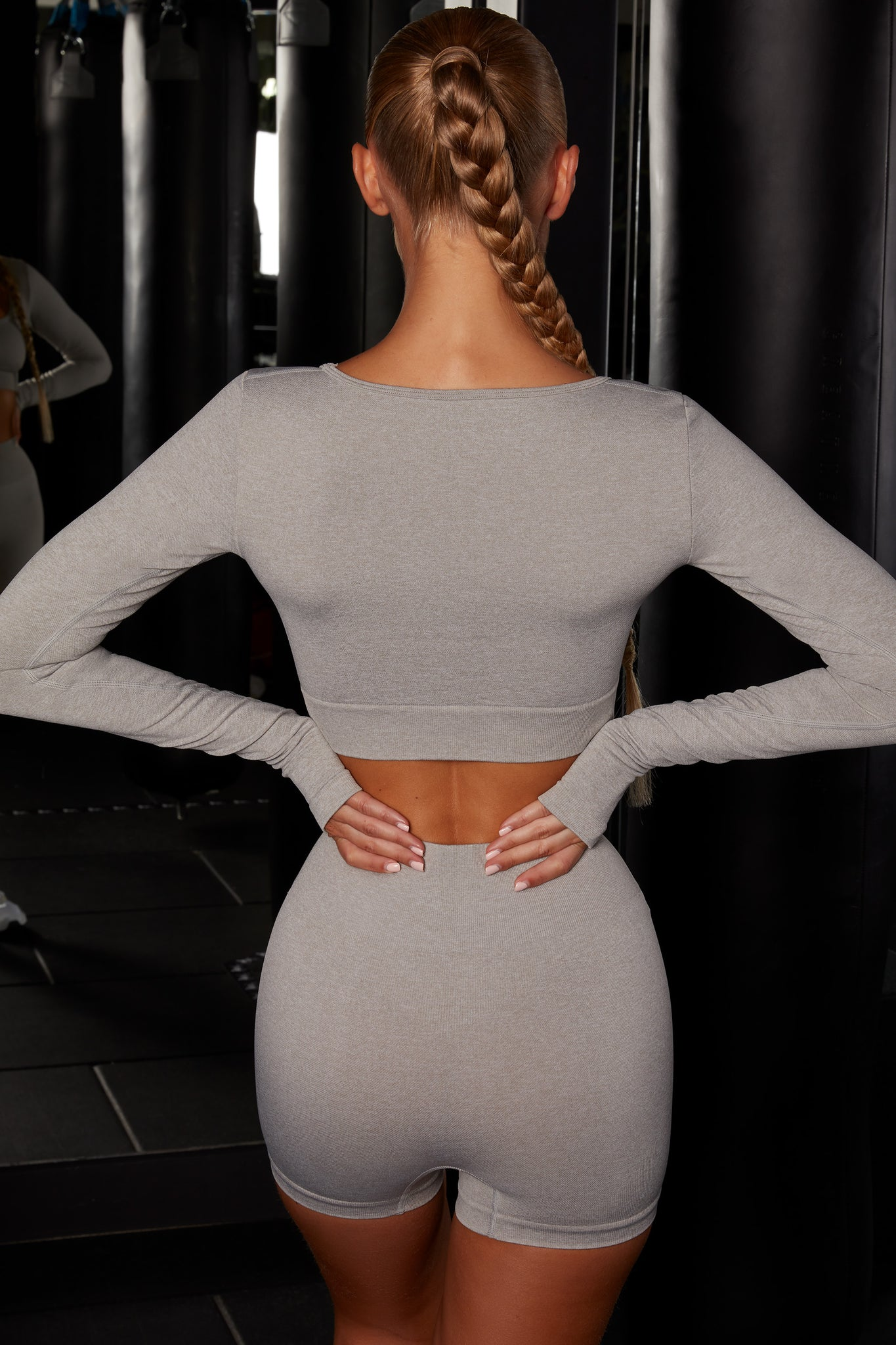 Plain grey melange scoop neck crop top with long sleeves. Image 3 of 6.