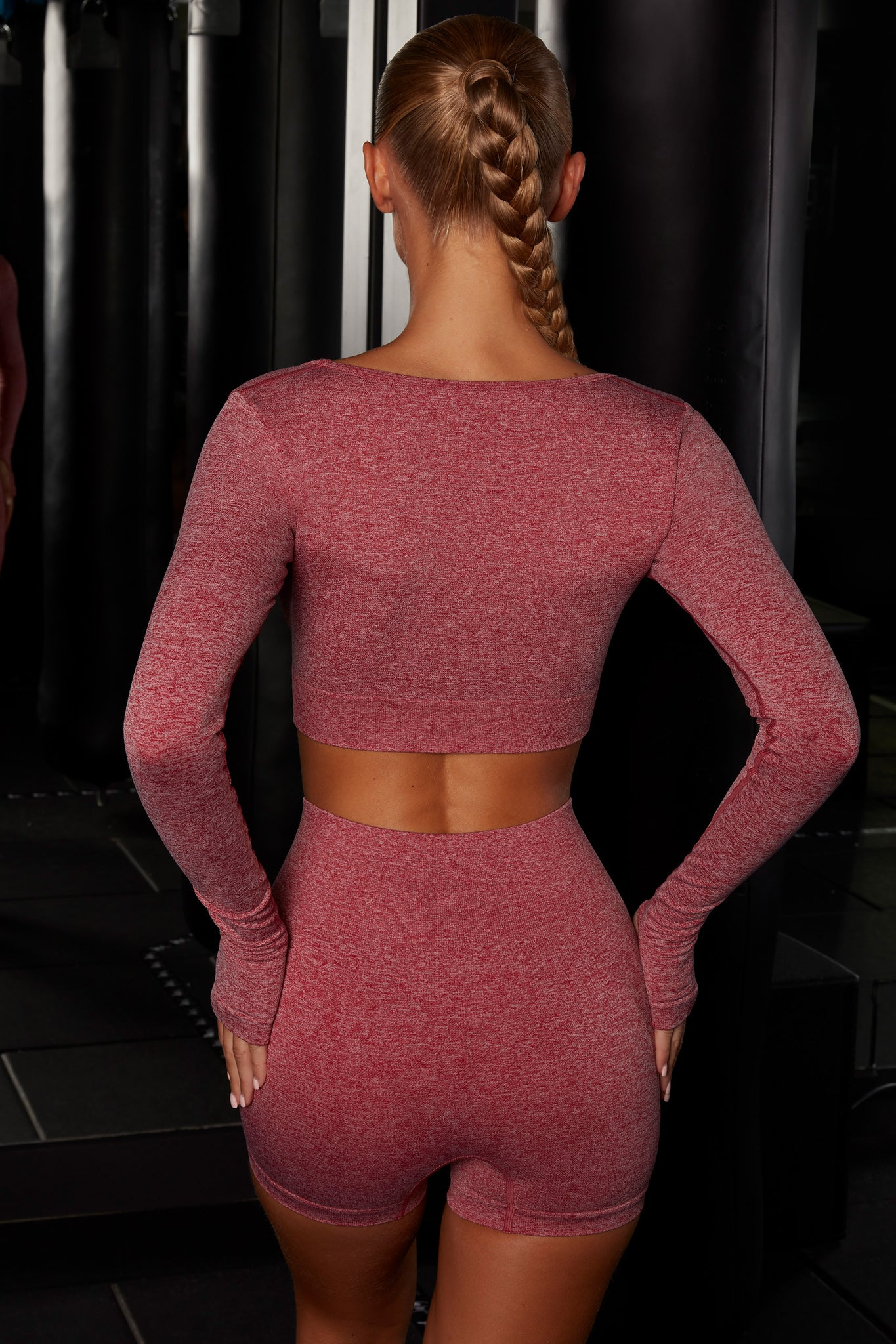 Plain red melange scoop neck crop top with long sleeves. Image 3 of 6.