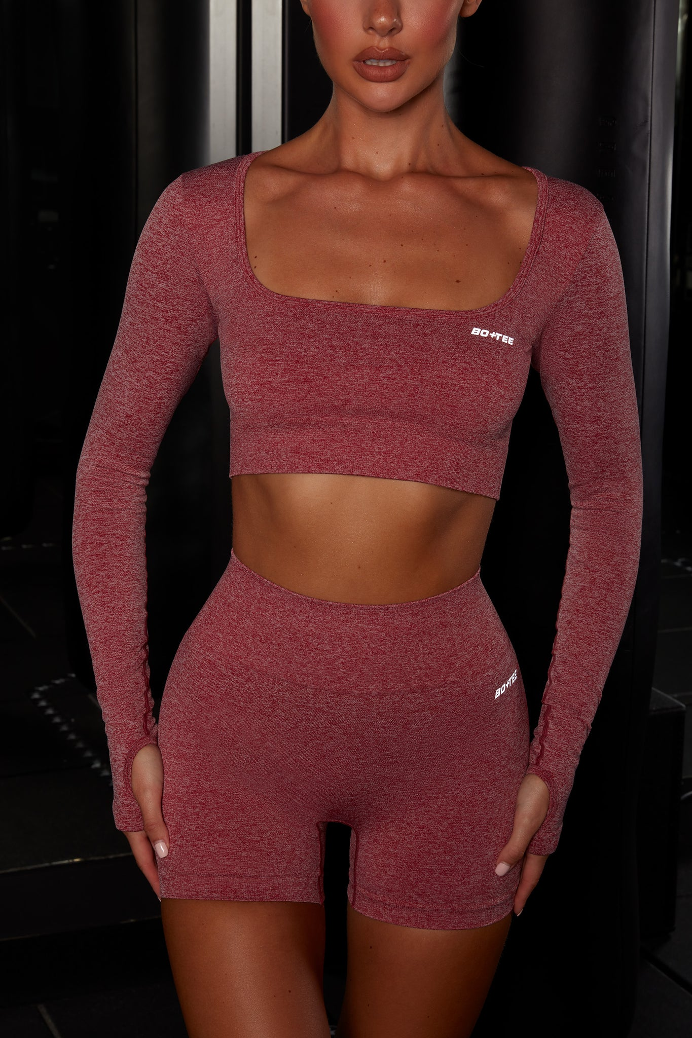Plain red melange scoop neck crop top with long sleeves. Image 1 of 6.