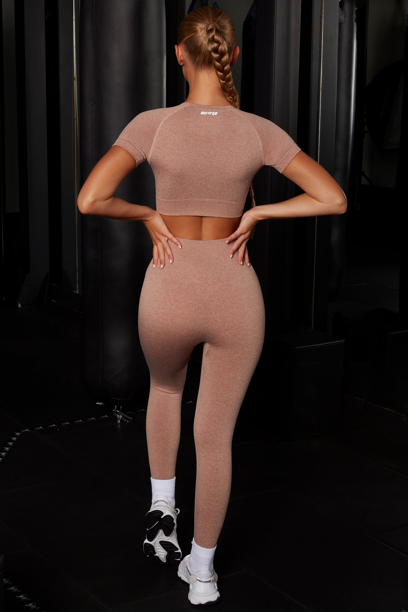 Plain brown melange seamless full length leggings with high waist and reflective branding. Image 3 of 6.