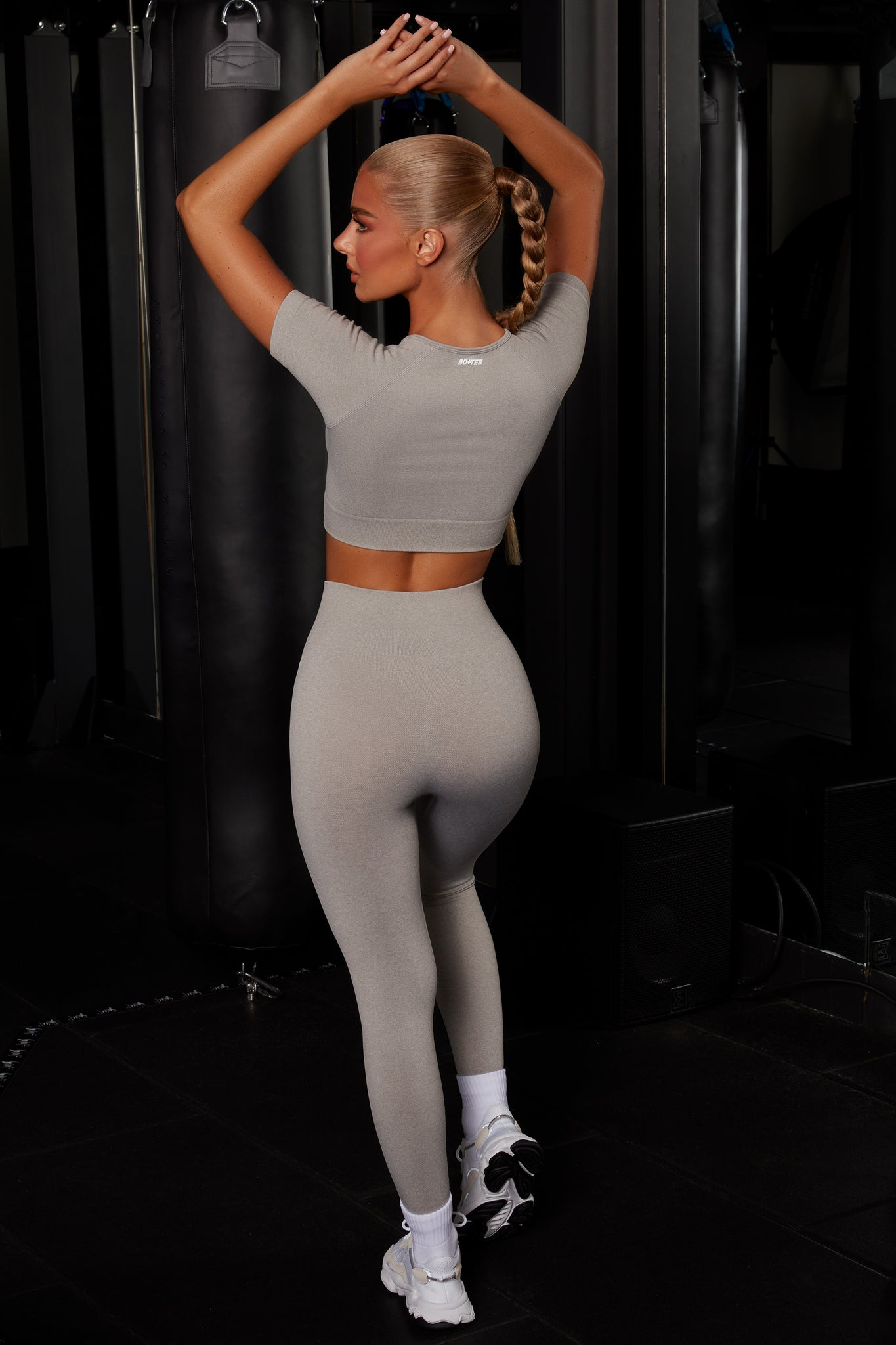 Plain grey melange seamless full length leggings with high waist and reflective branding. Image 3 of 6.