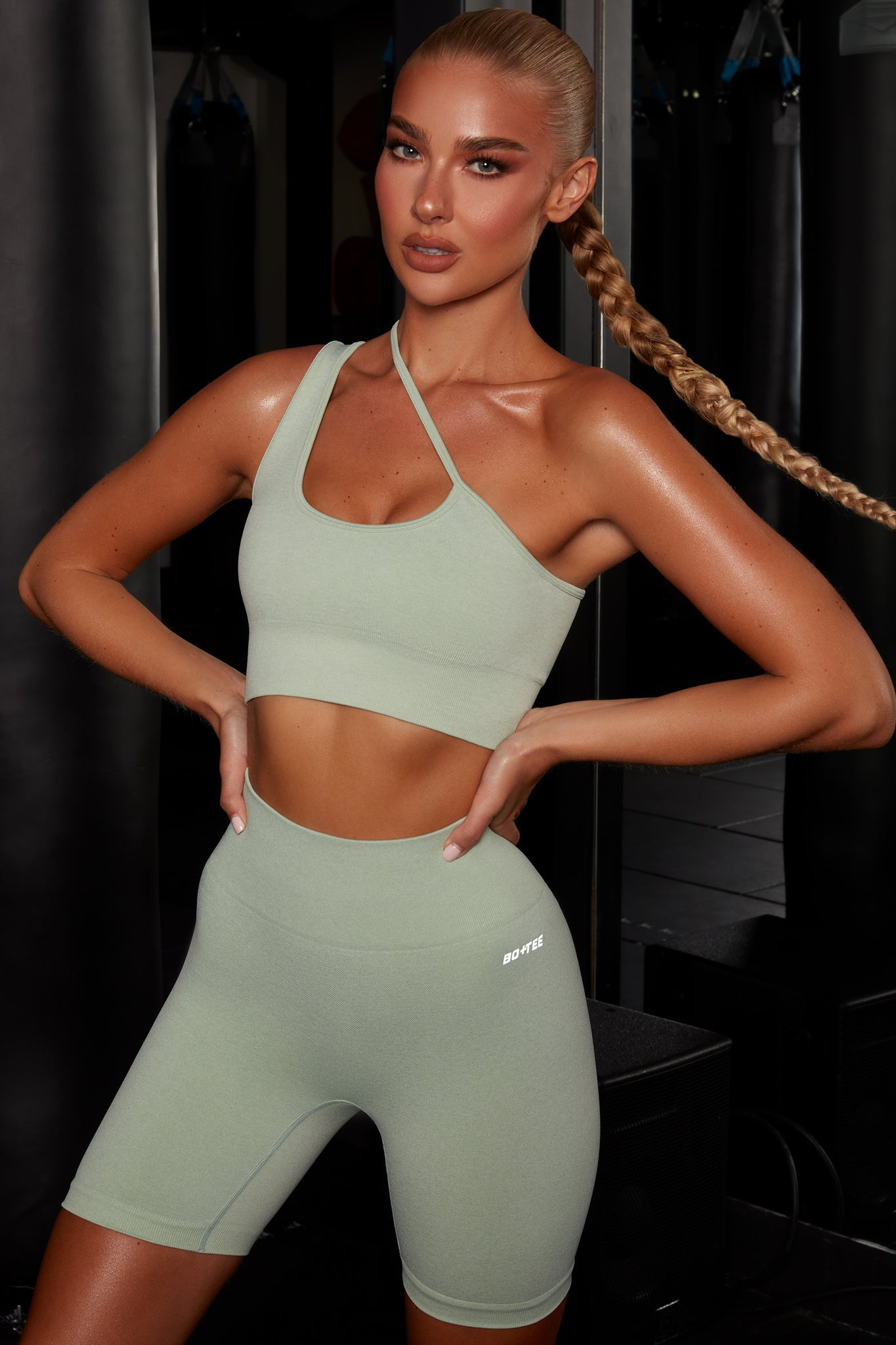 Plain green crop top with asymmetric strap. Image 6 of 6.
