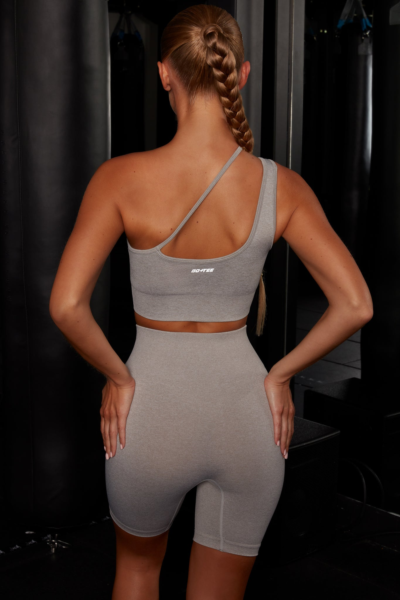 Plain grey crop top with asymmetric strap. Image 3 of 6.