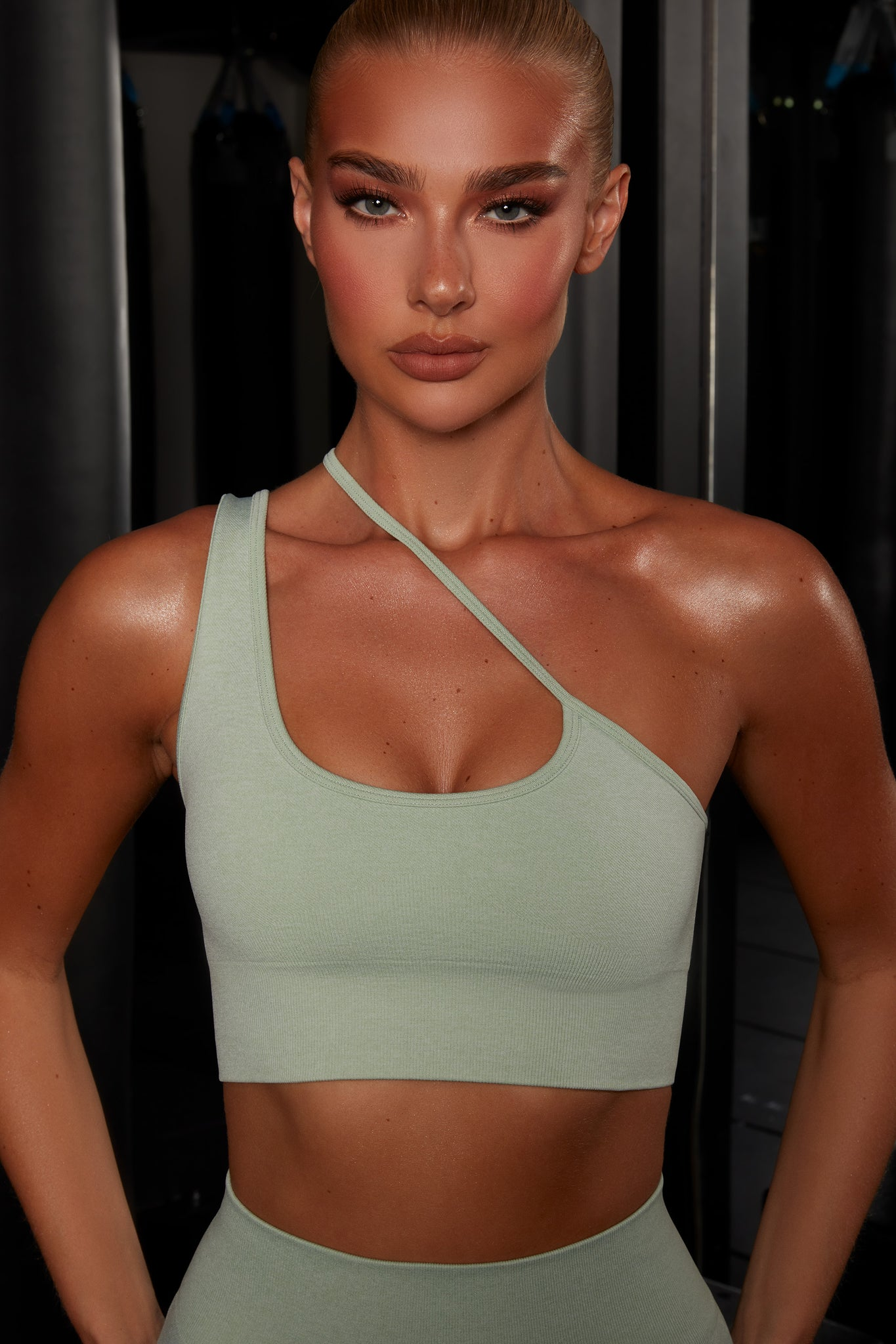 Plain green crop top with asymmetric strap. Image 4 of 6.