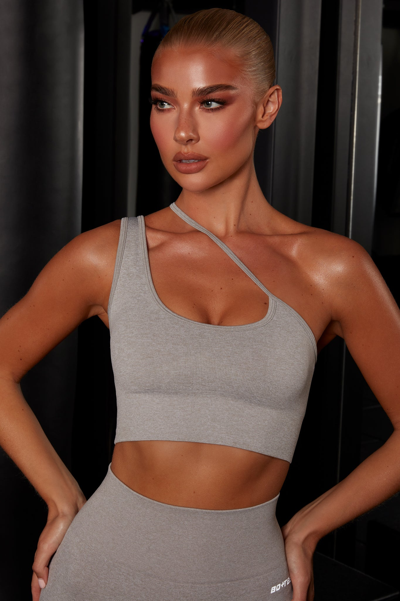 Plain grey crop top with asymmetric strap. Image 1 of 6.