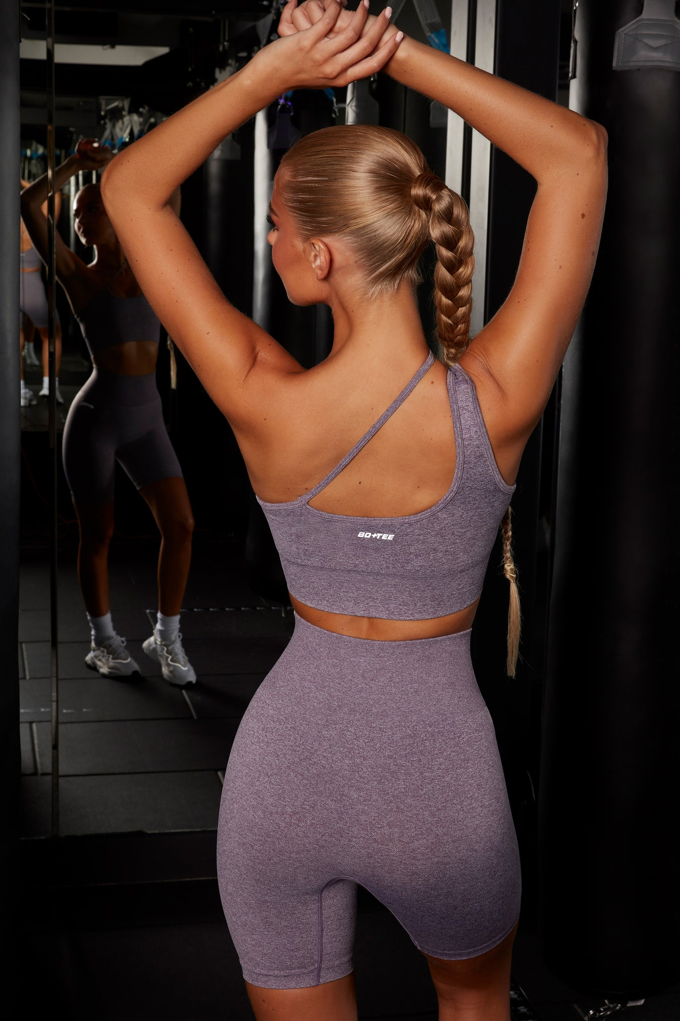 Plain purple melange seamless high waisted cycling shorts. Image 3 of 6.