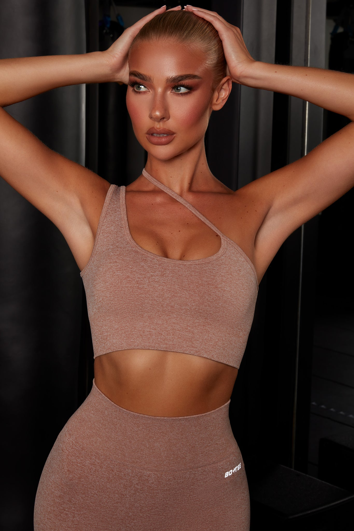 Plain brown crop top with asymmetric strap. Image 1 of 6.
