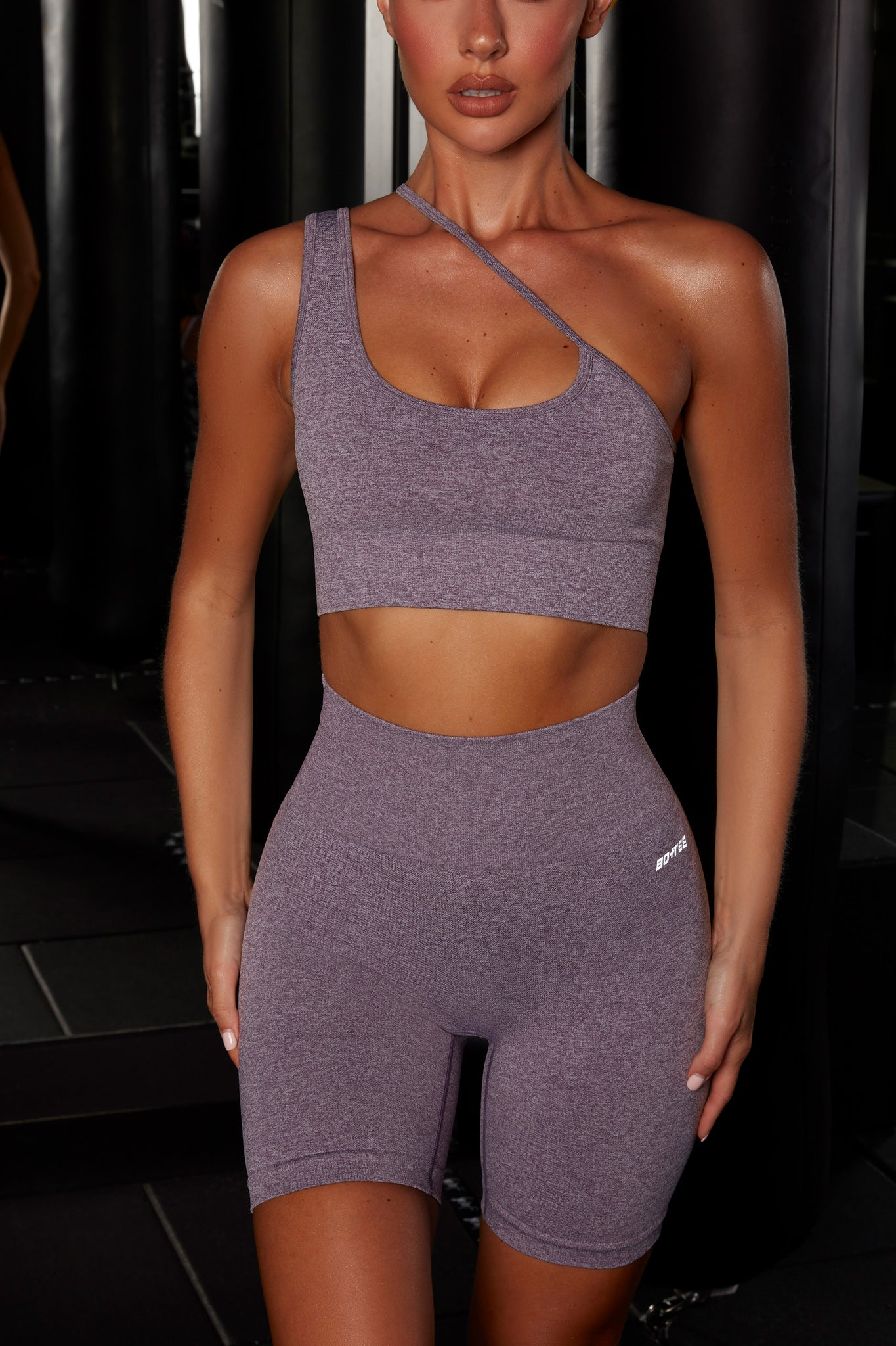 Plain purple crop top with asymmetric strap. Image 4 of 6.