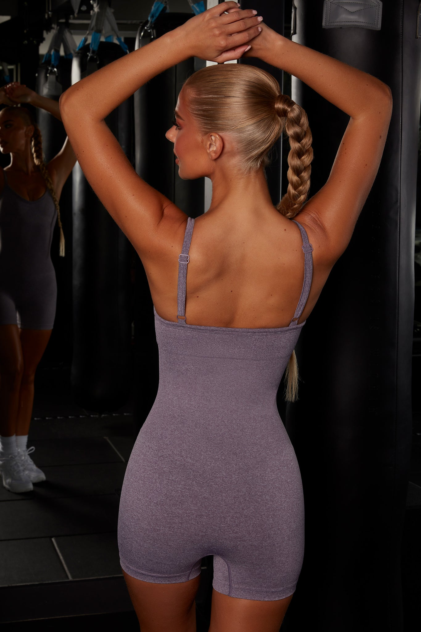 Plain purple seamless unitard with plunge neck and adjustable straps. Image 3 of 6.