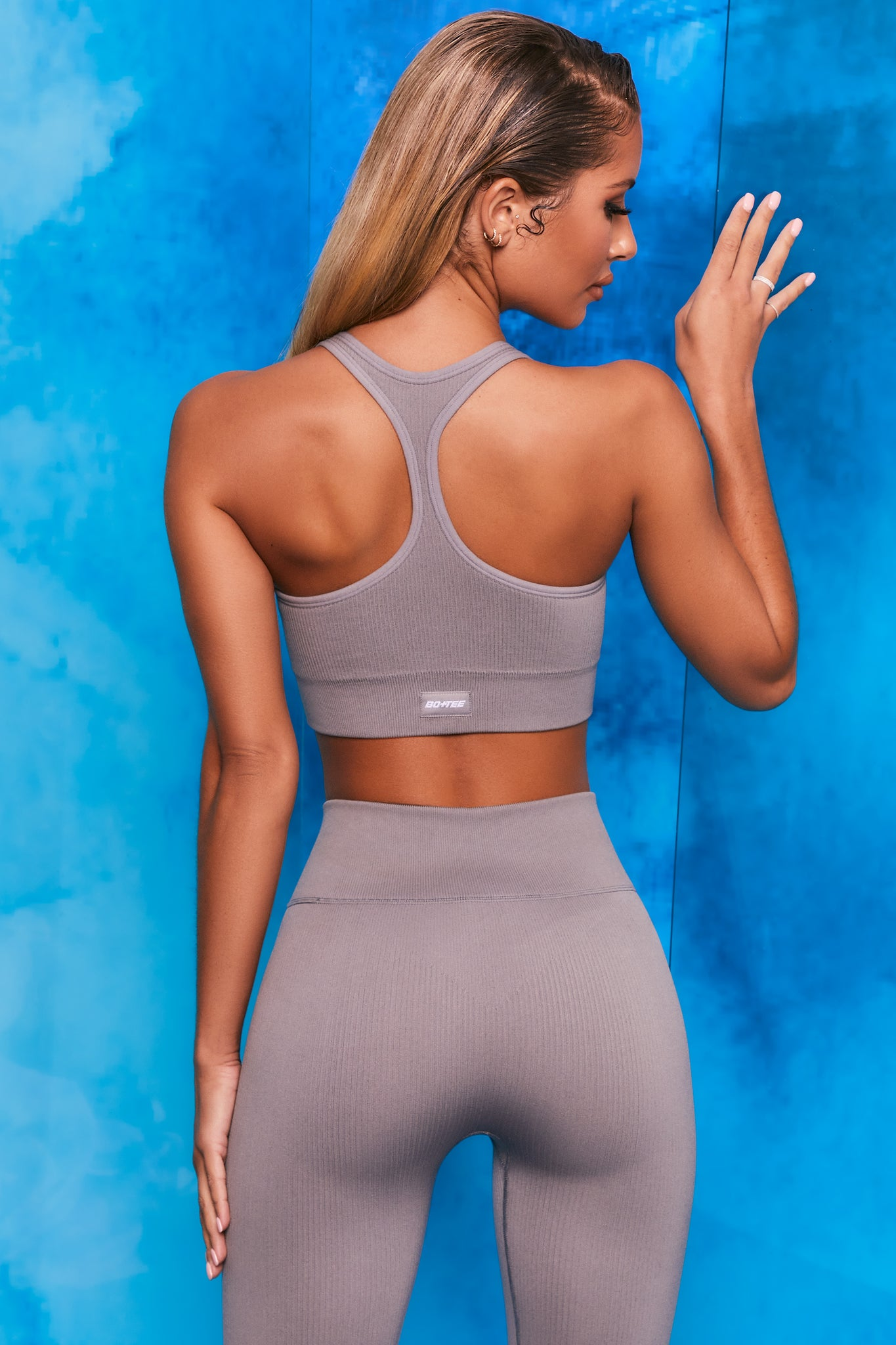 Plain grey ribbed scoop neck sports bra with zip front and racer back. Image 3 of 6