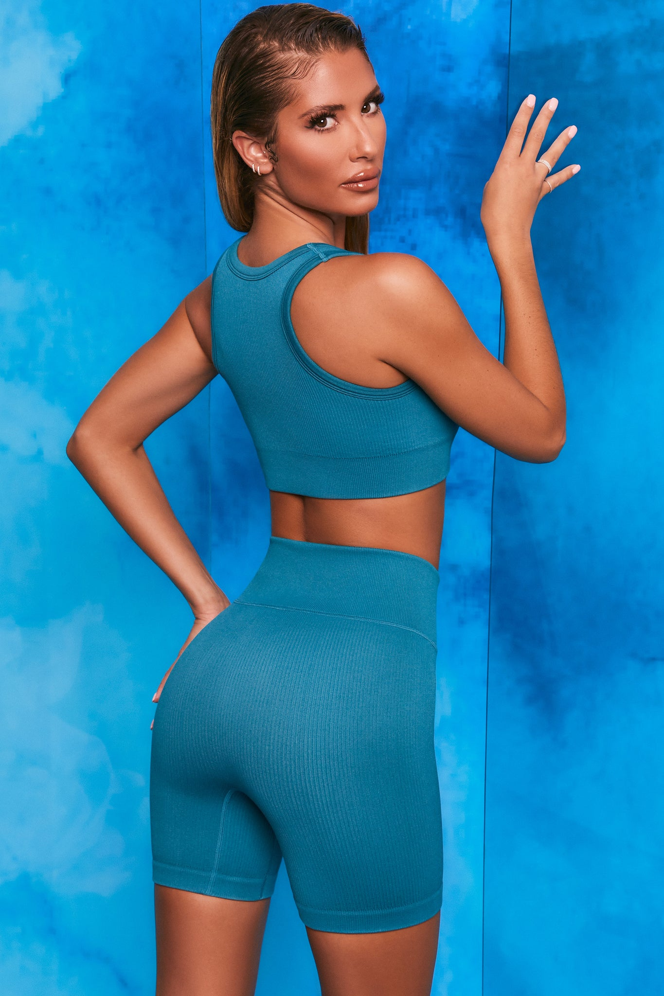 Teal ribbed cycling shorts with tie front. Image 3 of 6.