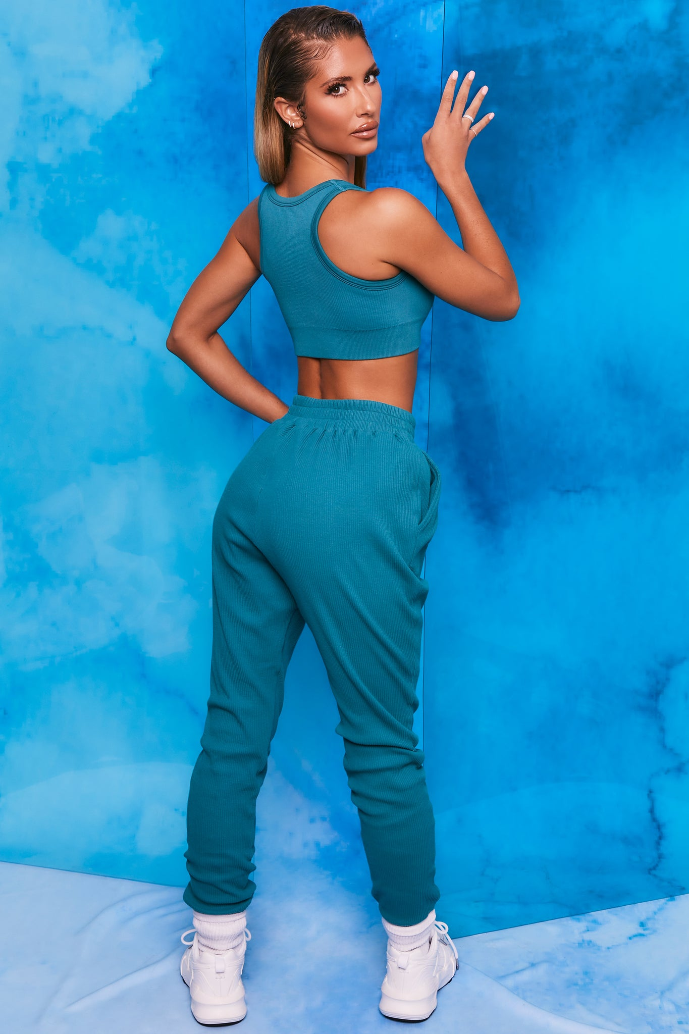 Teal ribbed full length cuffed joggers. Image 3 of 6.